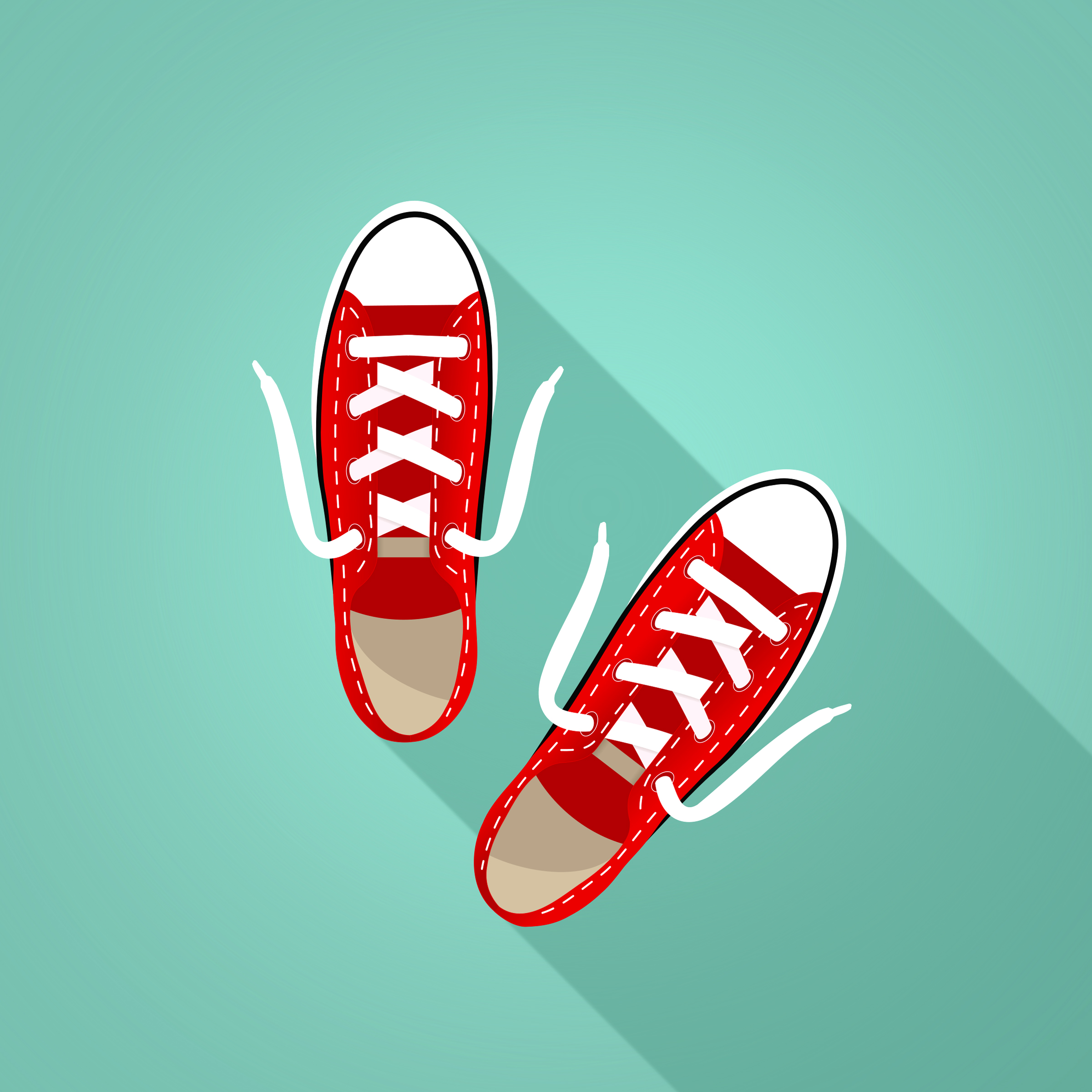 Red sneakers on turquoise background photo