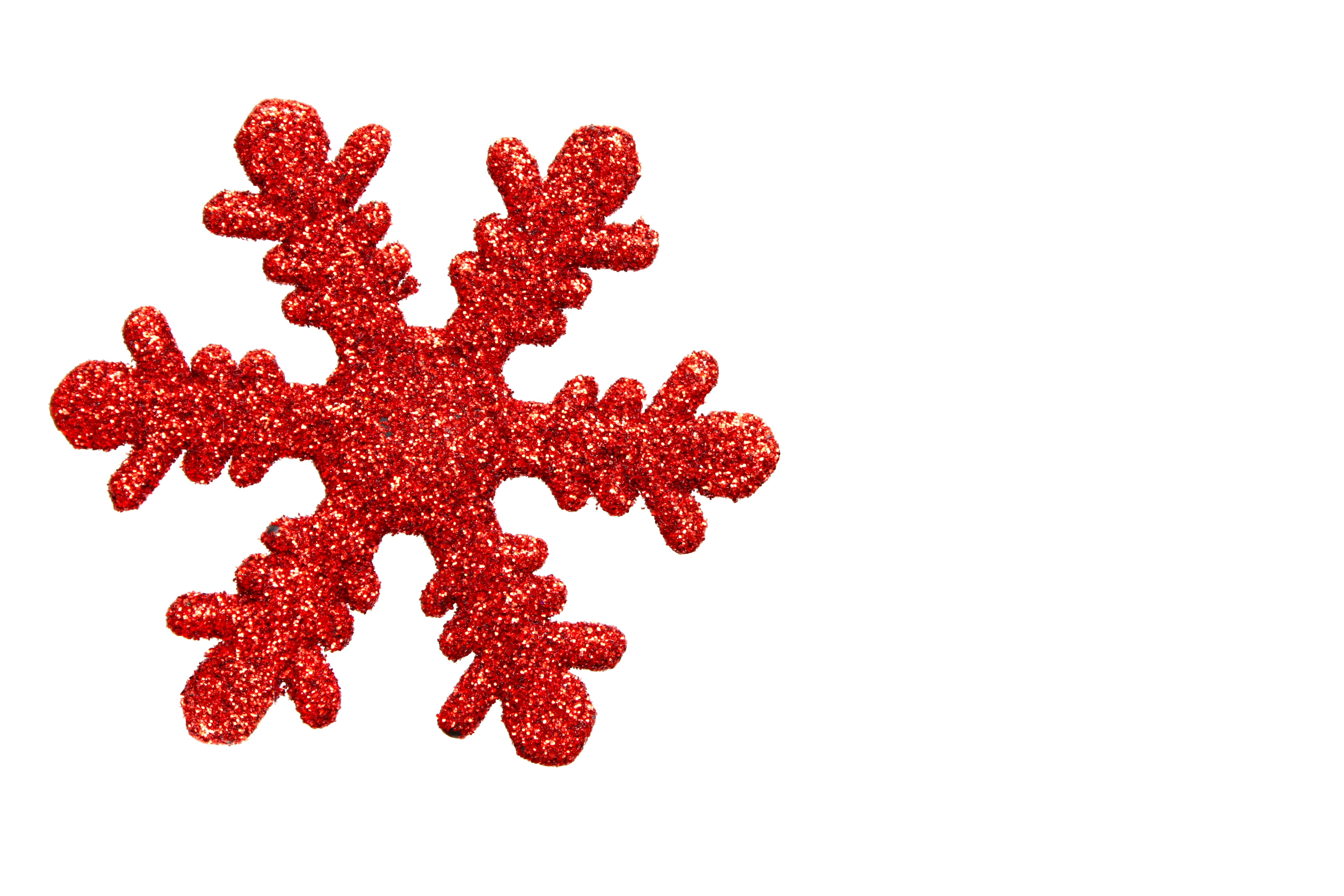 Red snowflake shaped christmas ornament photo