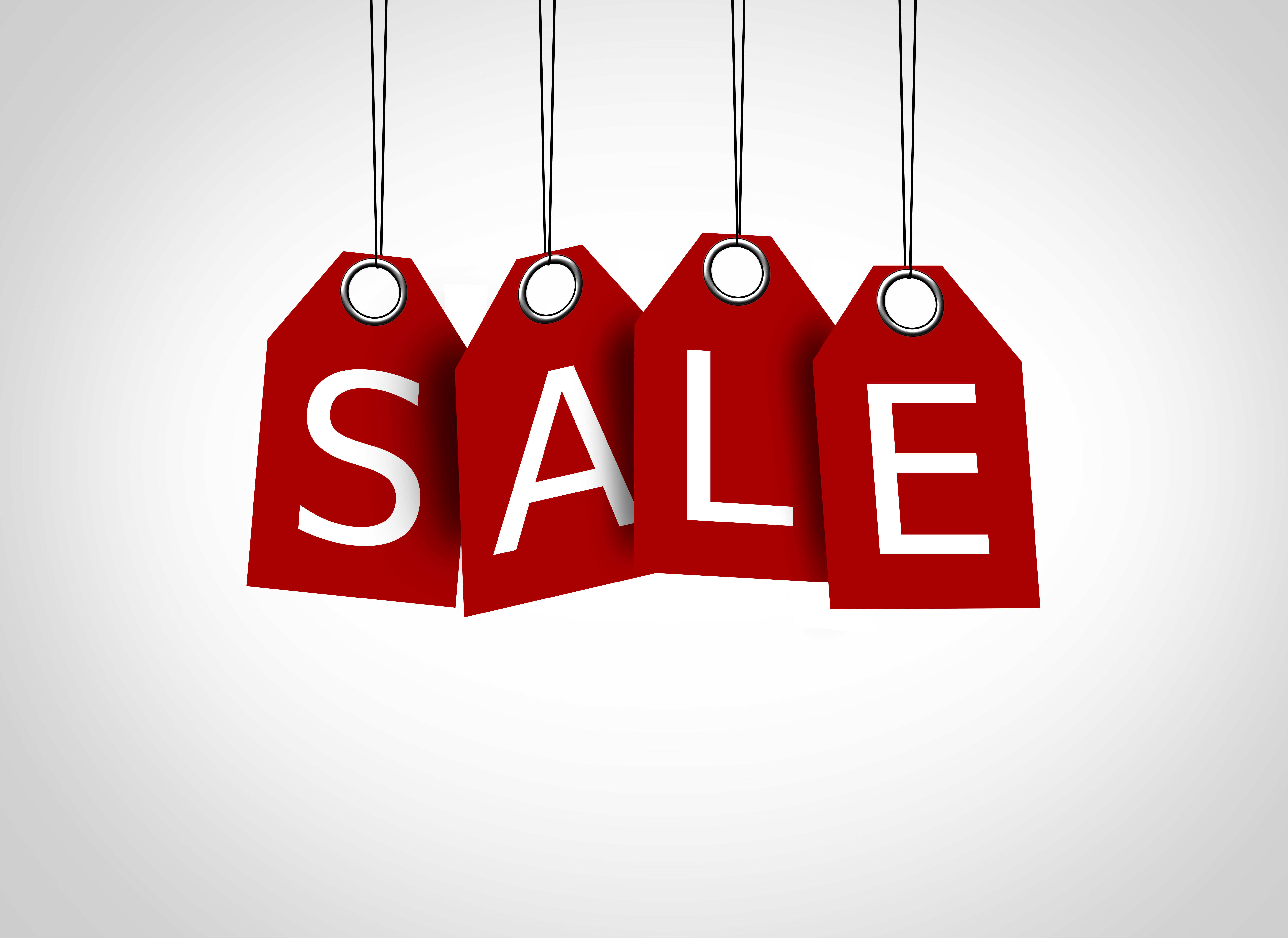 Red tags dangling with the word sale - sales concept photo