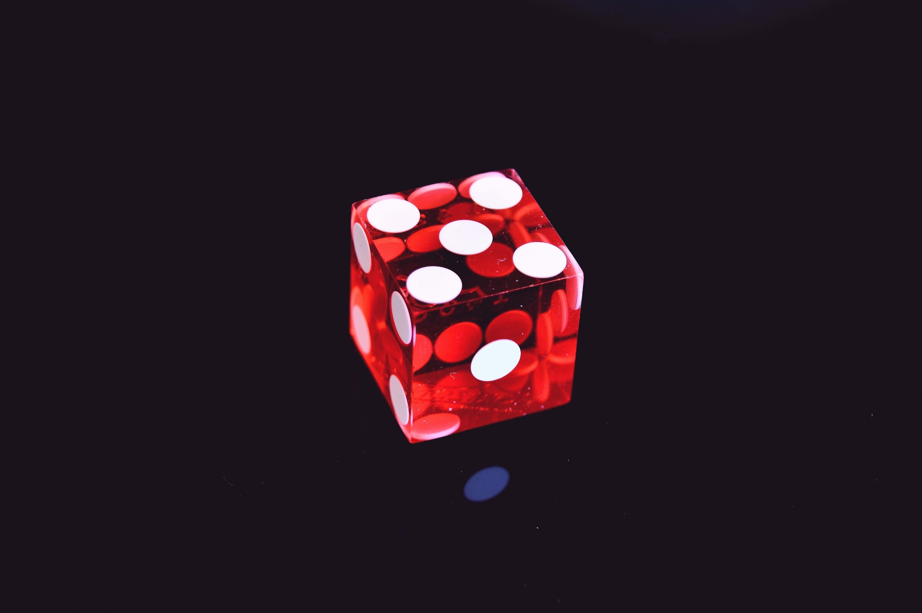Red Translucent Die on Top of Black Surface, Black background, Close-up, Colors, Cube, HQ Photo