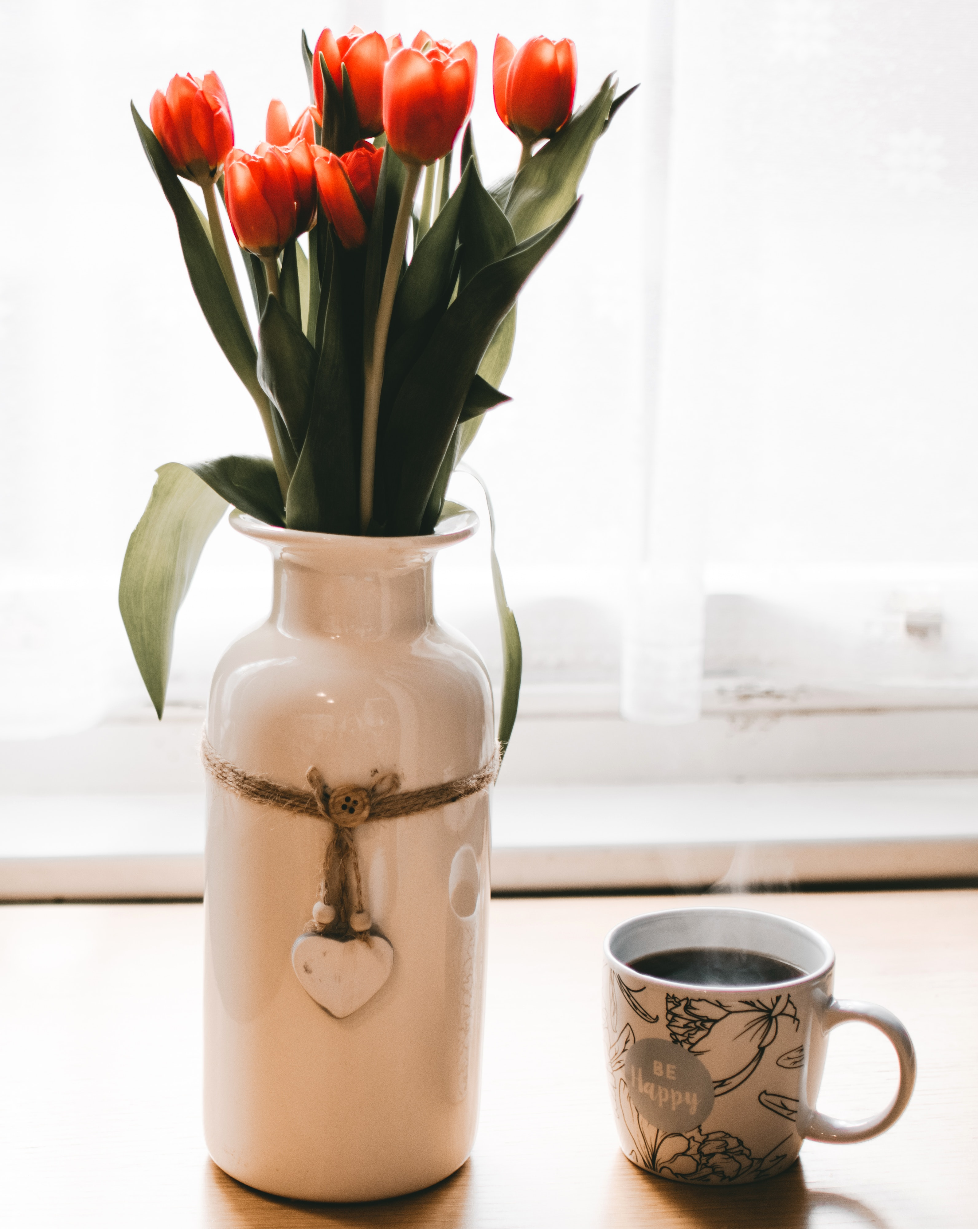 Red Tulips Flowers in White Ceramic Vase Beside Cup of Coffee, Flower vase, Tulips, Table, Porcelain, HQ Photo