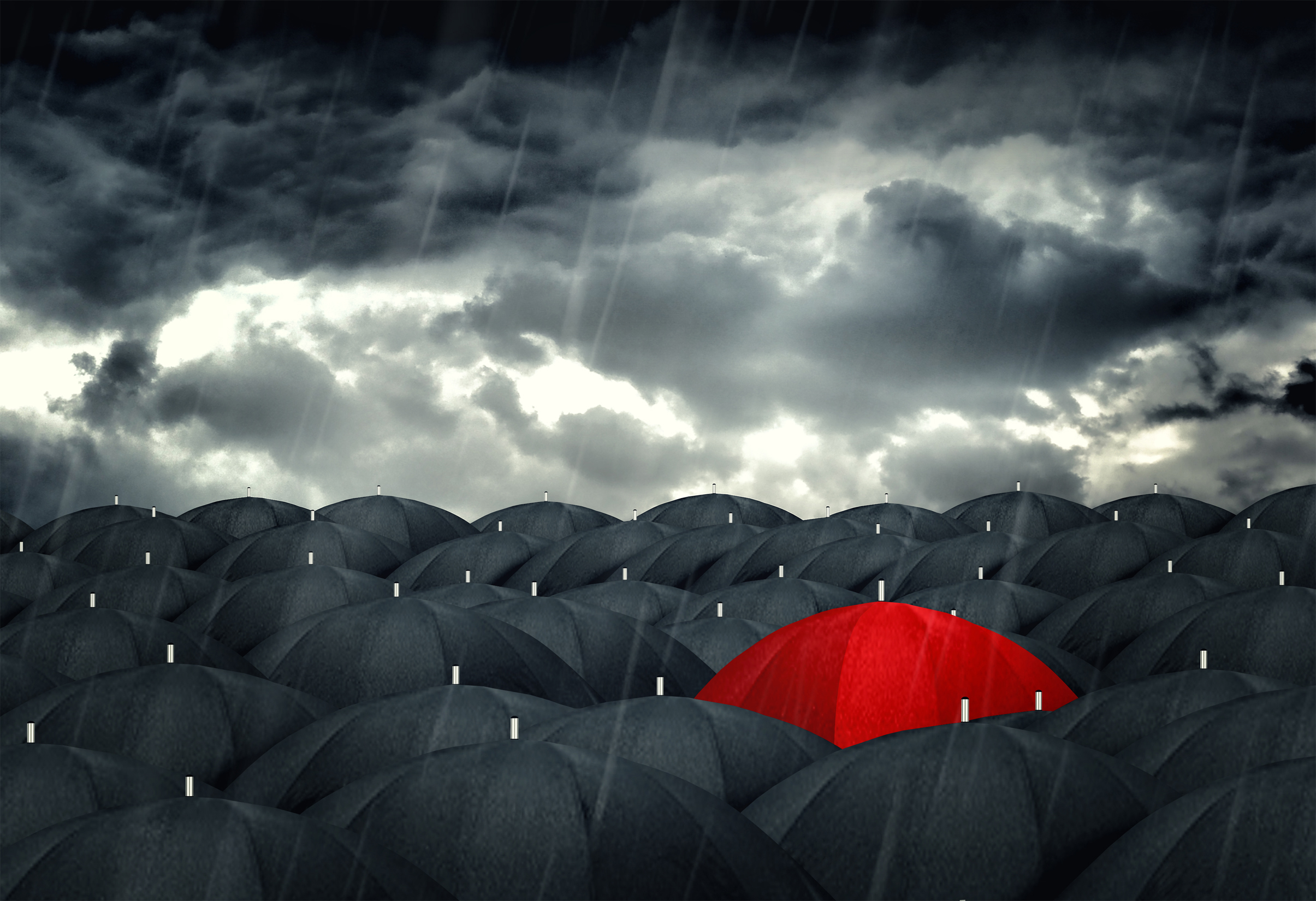 Red umbrella mingling with grey umbrellas - be different concept photo