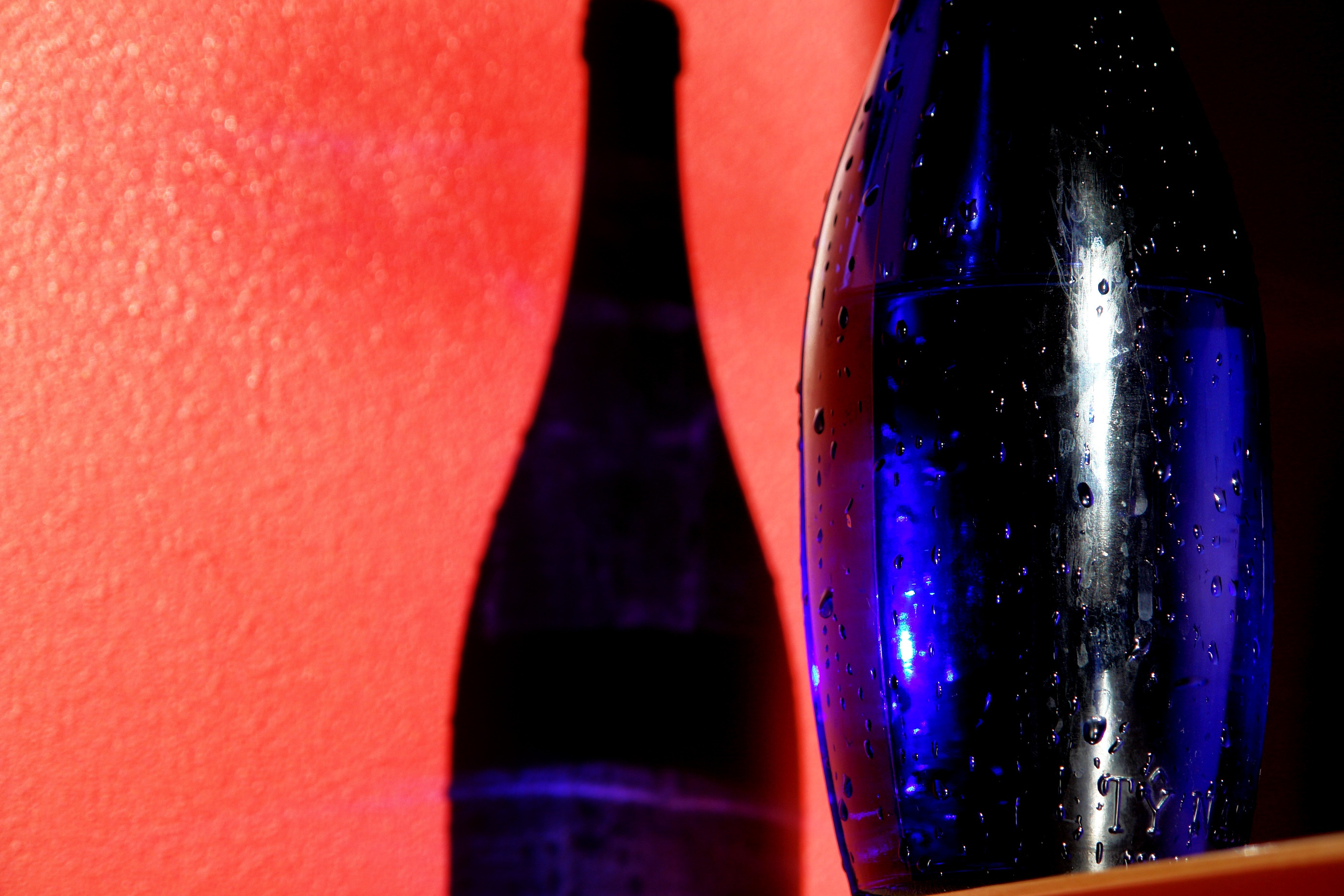 Red wall and blue bottle photo