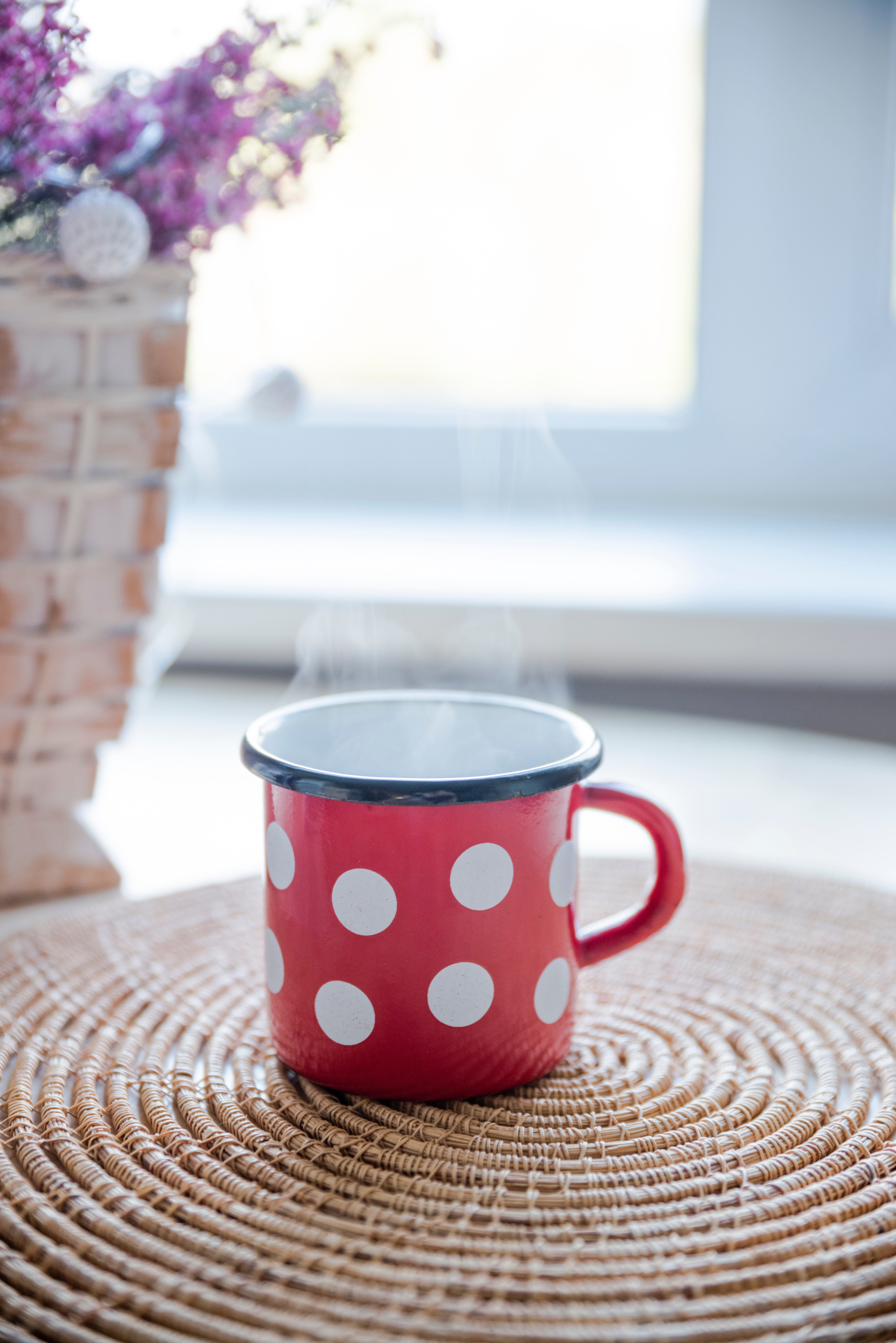 Red, white, and black ceramic mug on table photo