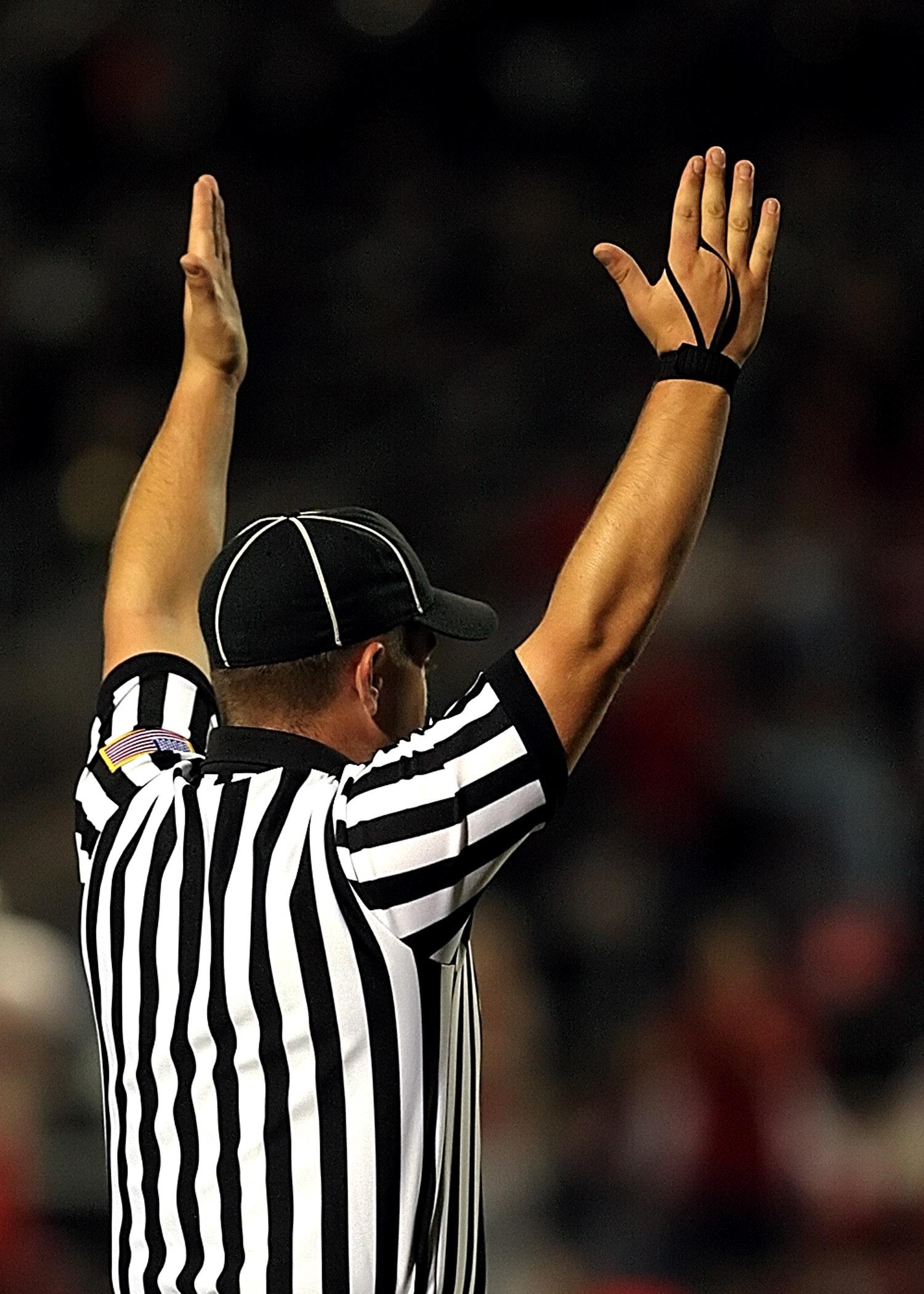 Referee raising both hands photo