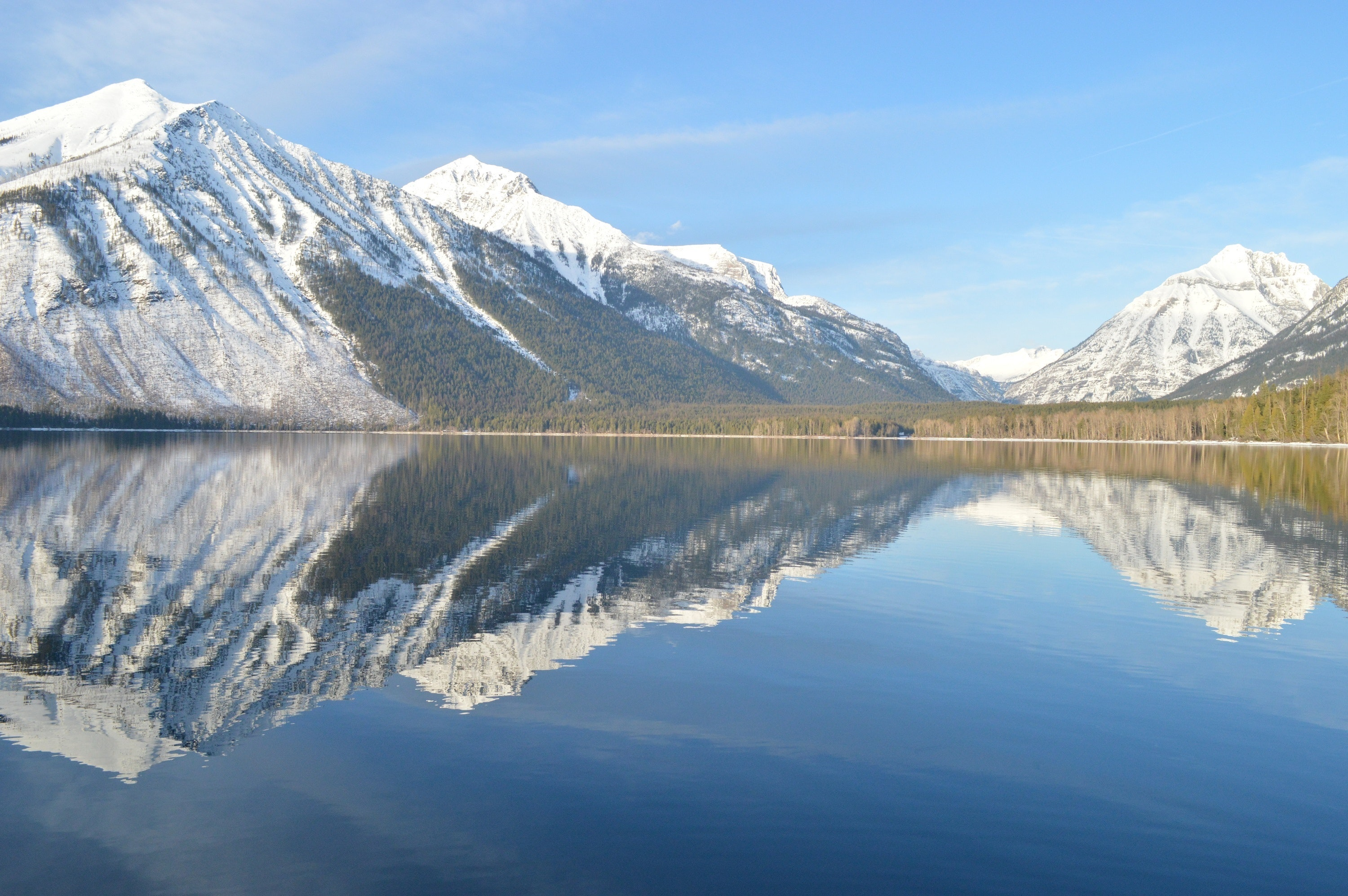 Reflection of mountains in lake against sky photo