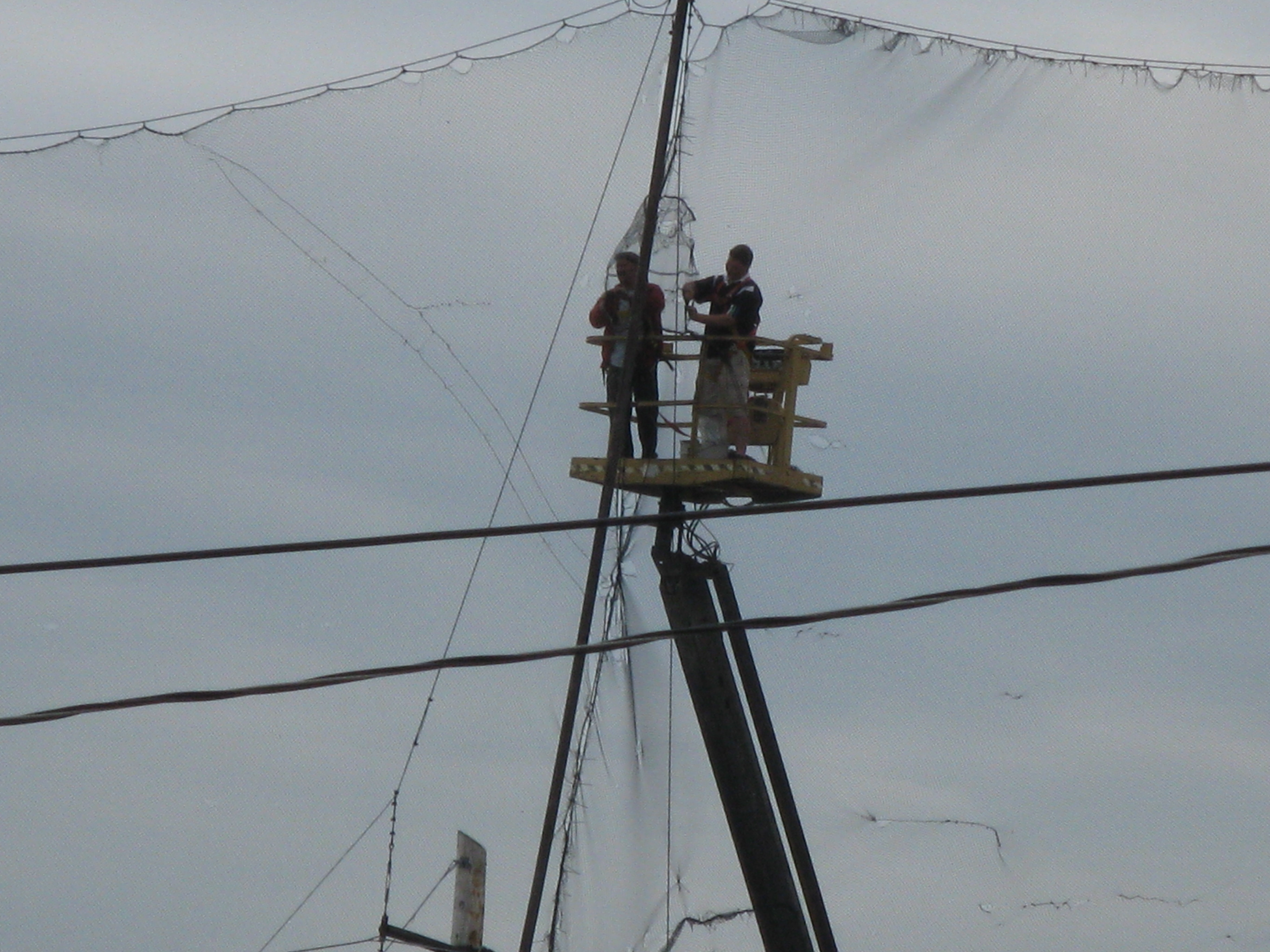 Repairing a net at a golf driving range -d.jpg photo