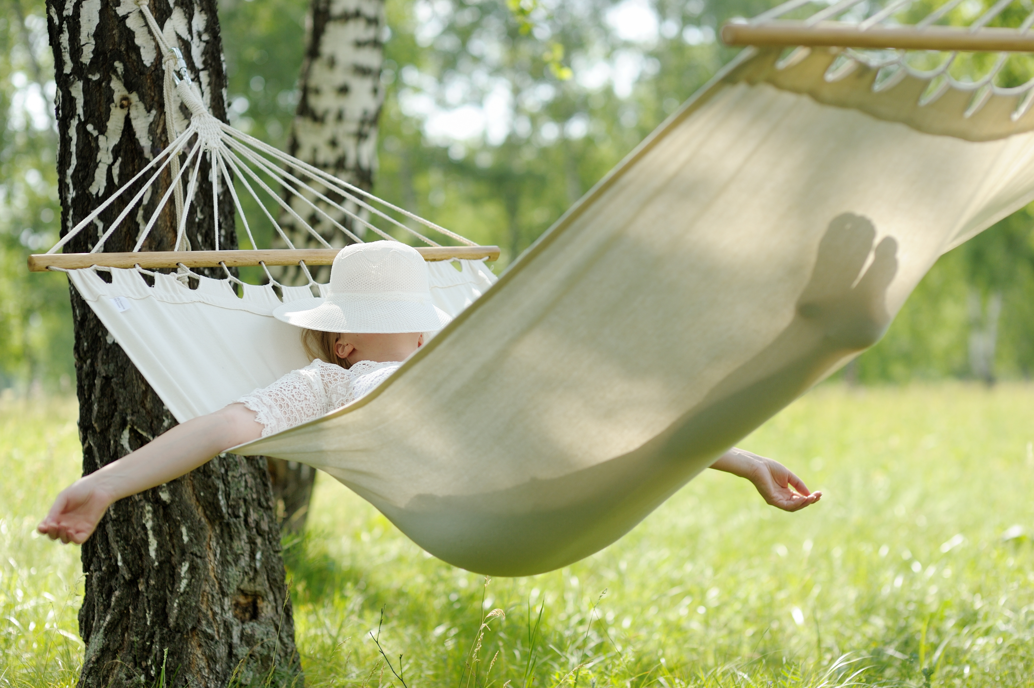 Woman resting in hammock. - The Rise & Shine