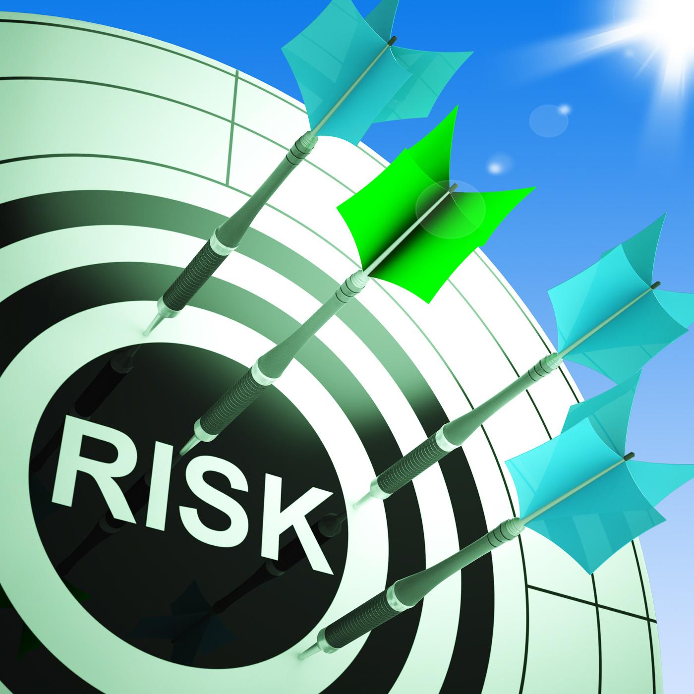 Risk on dartboard showing dangerous photo