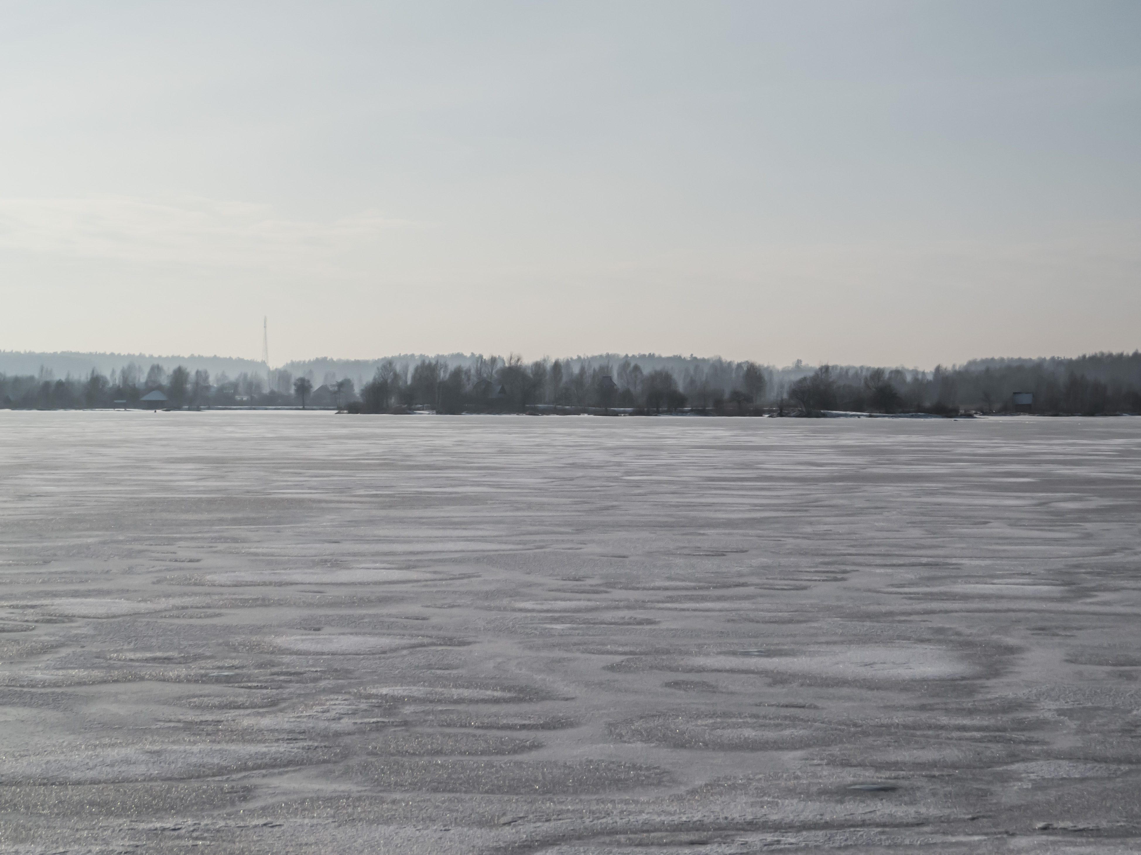 River covered with a thick layer of ice photo