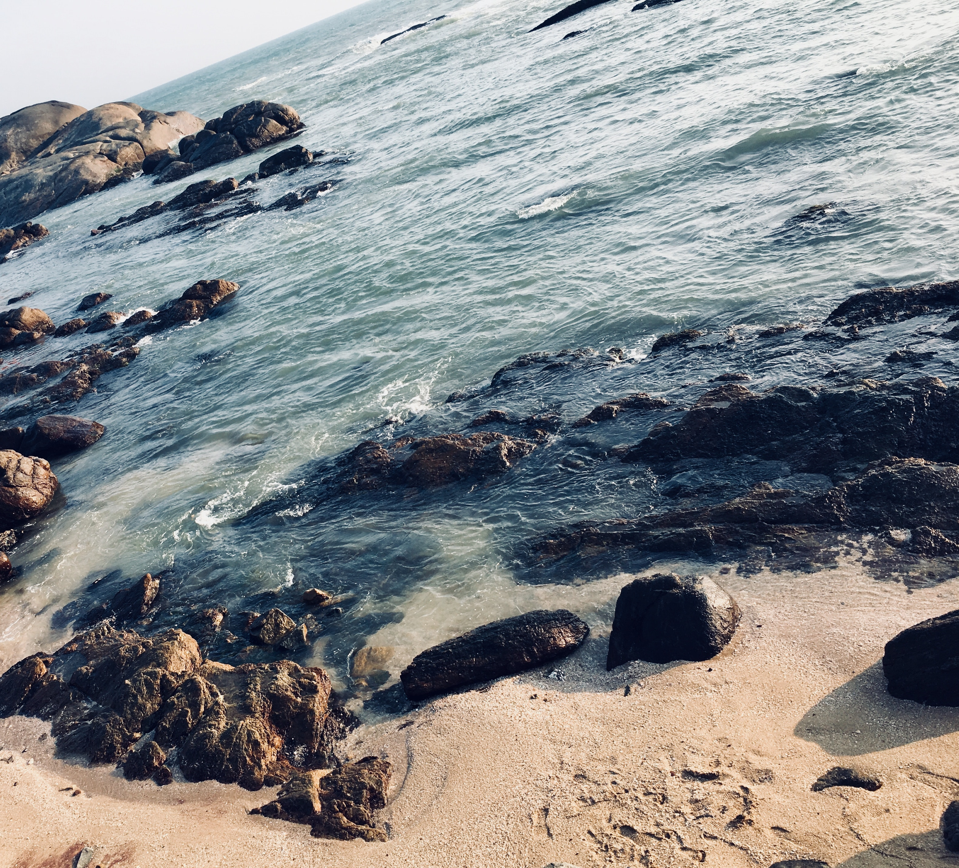 Rocks on seashore photo