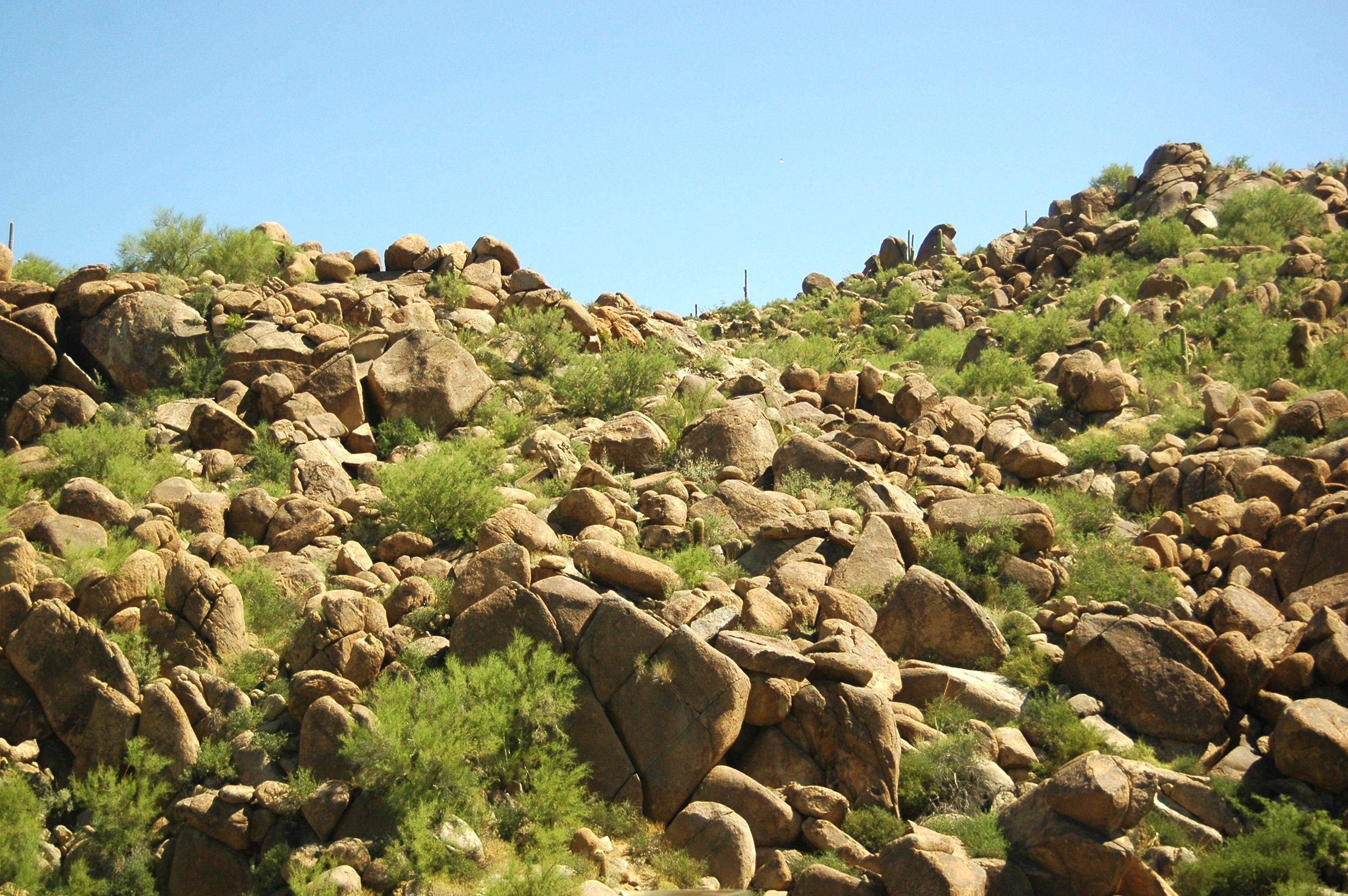 Rocky desert hillside photo