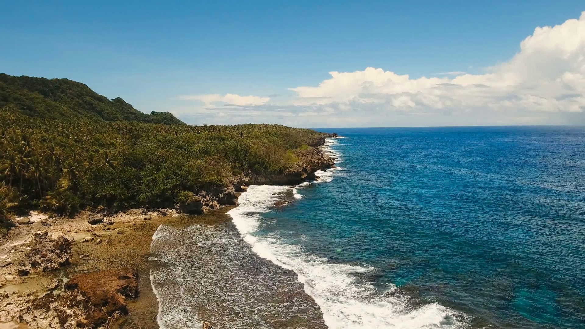 Rocky coast line of Island Siargao. Aerial view sea rocky coast ...