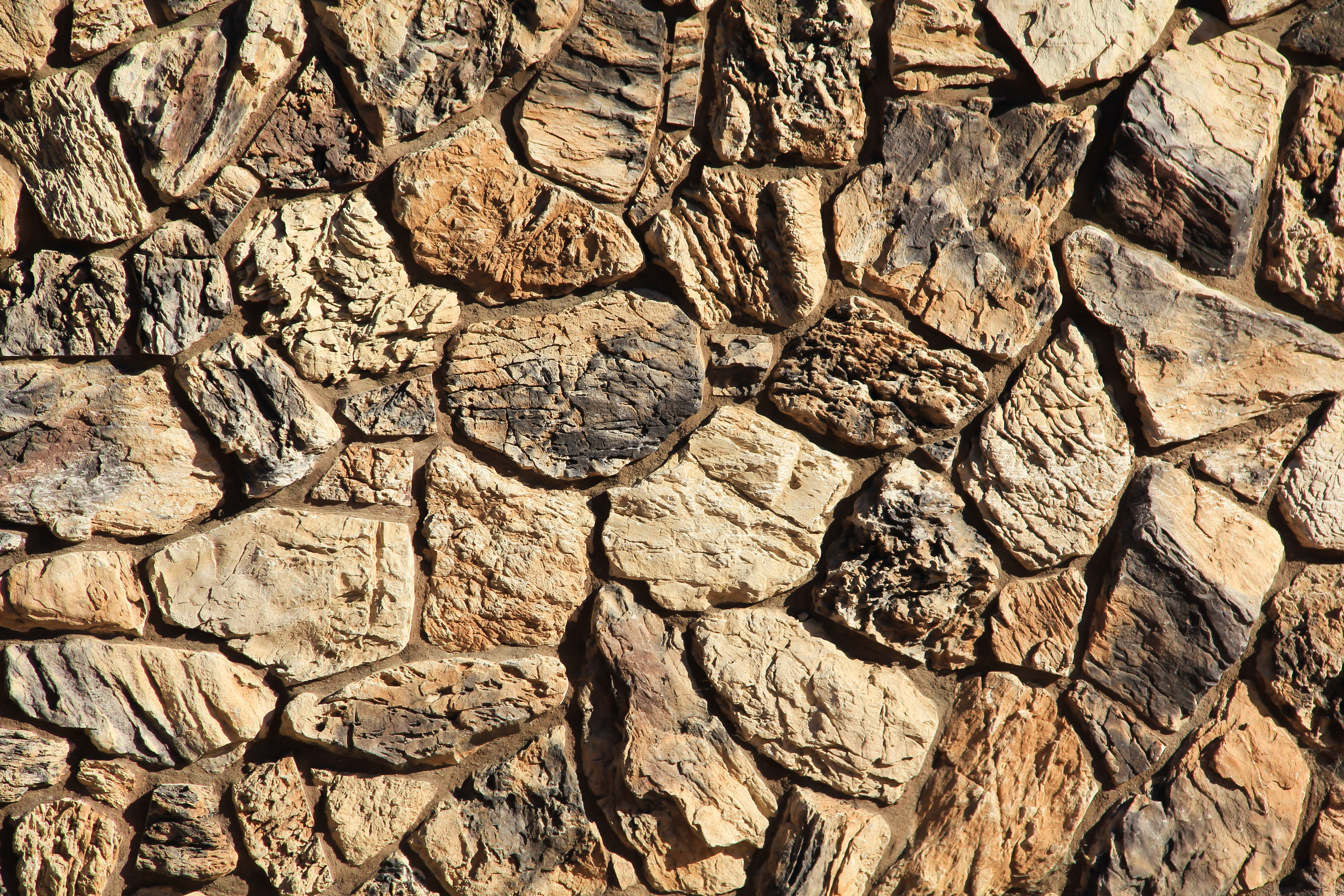 Stone Texture rock wall jagged rough brown masonry stock image ...