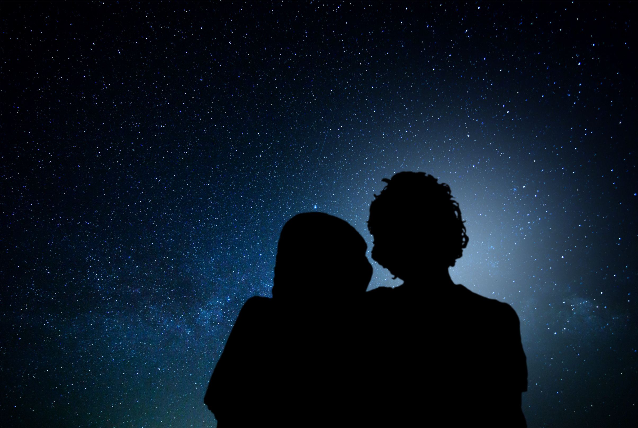 Romantic couple watching the stars photo