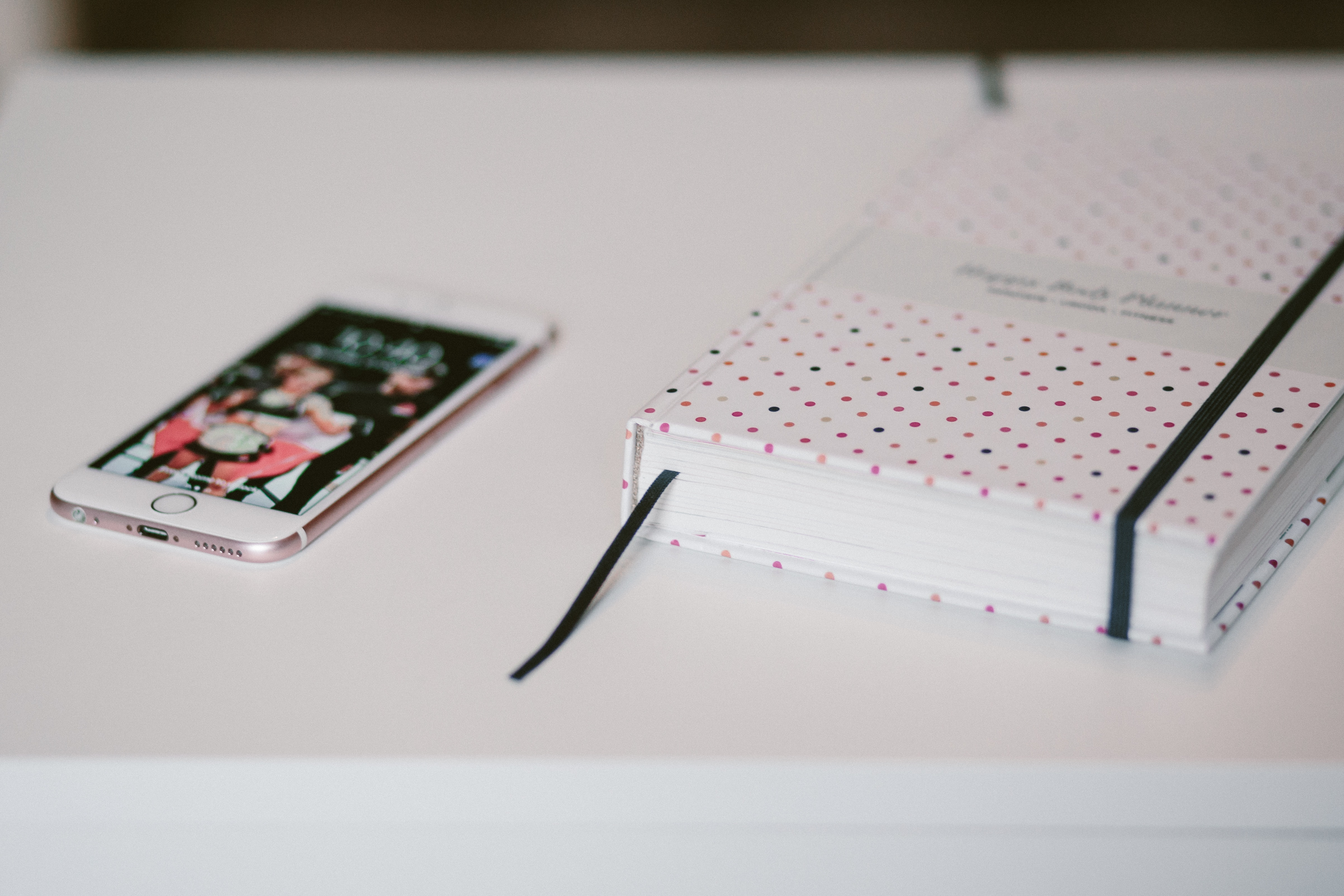 Free Photo Rose Gold Iphone 6s Beside White And Black Polka Dots