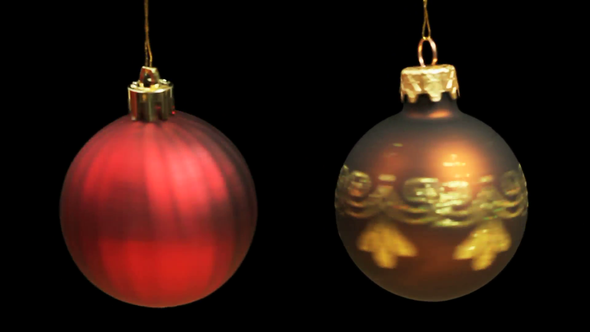 Red and Gold Christmas Baubles rotating each on its own string until ...