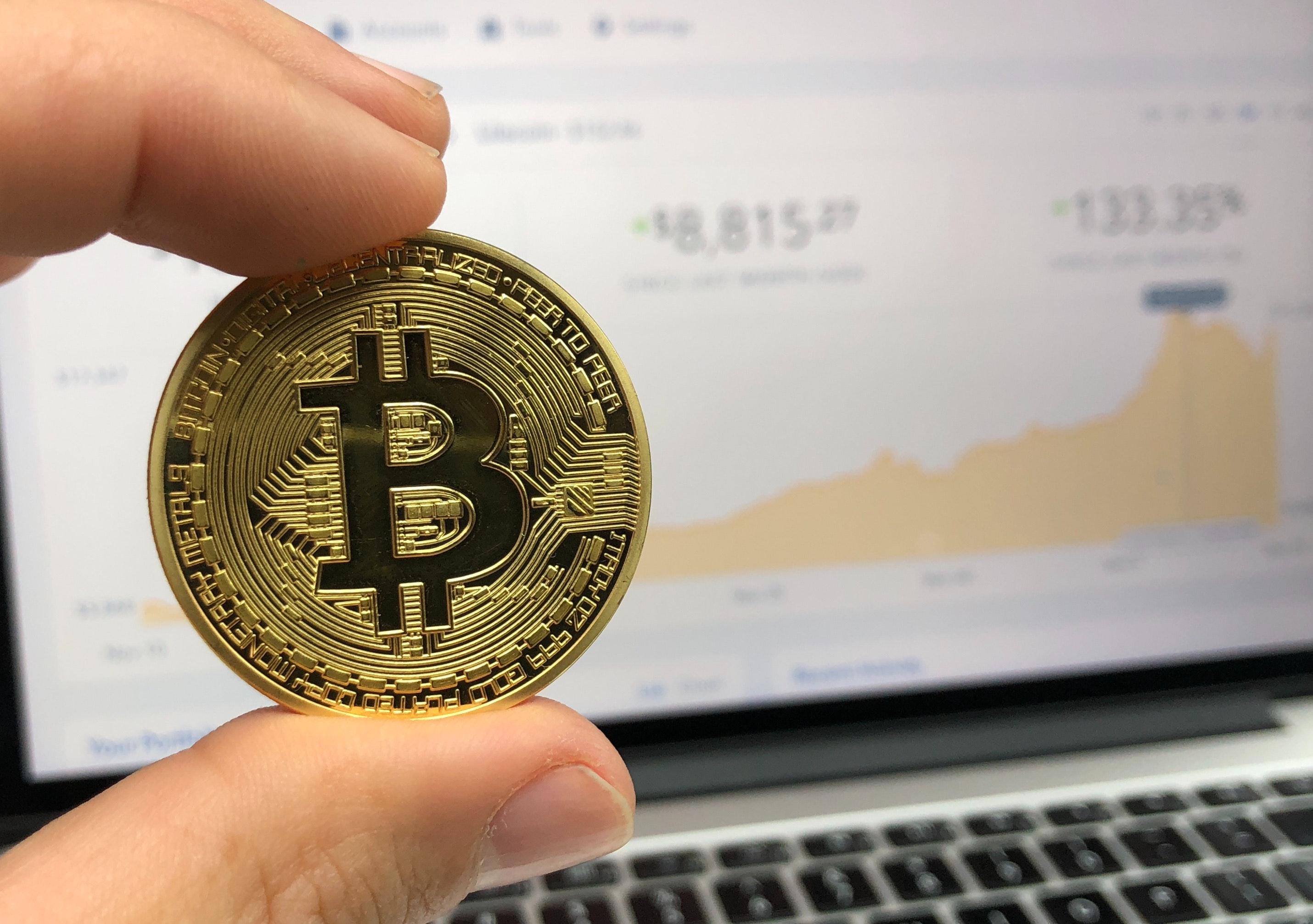 Round gold-colored bitcoin photo