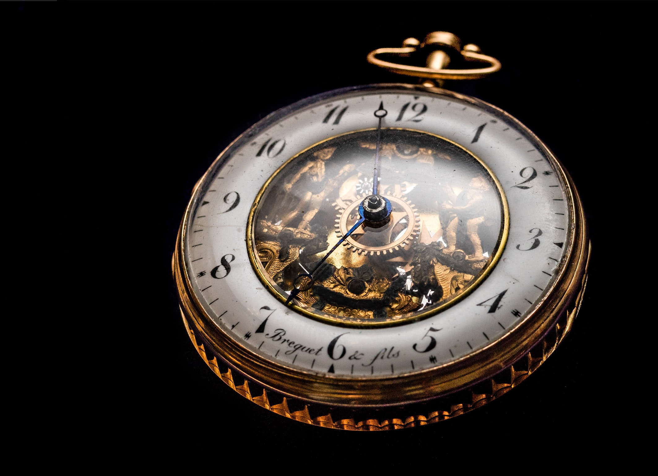 Round gold-colored pocket watch photo