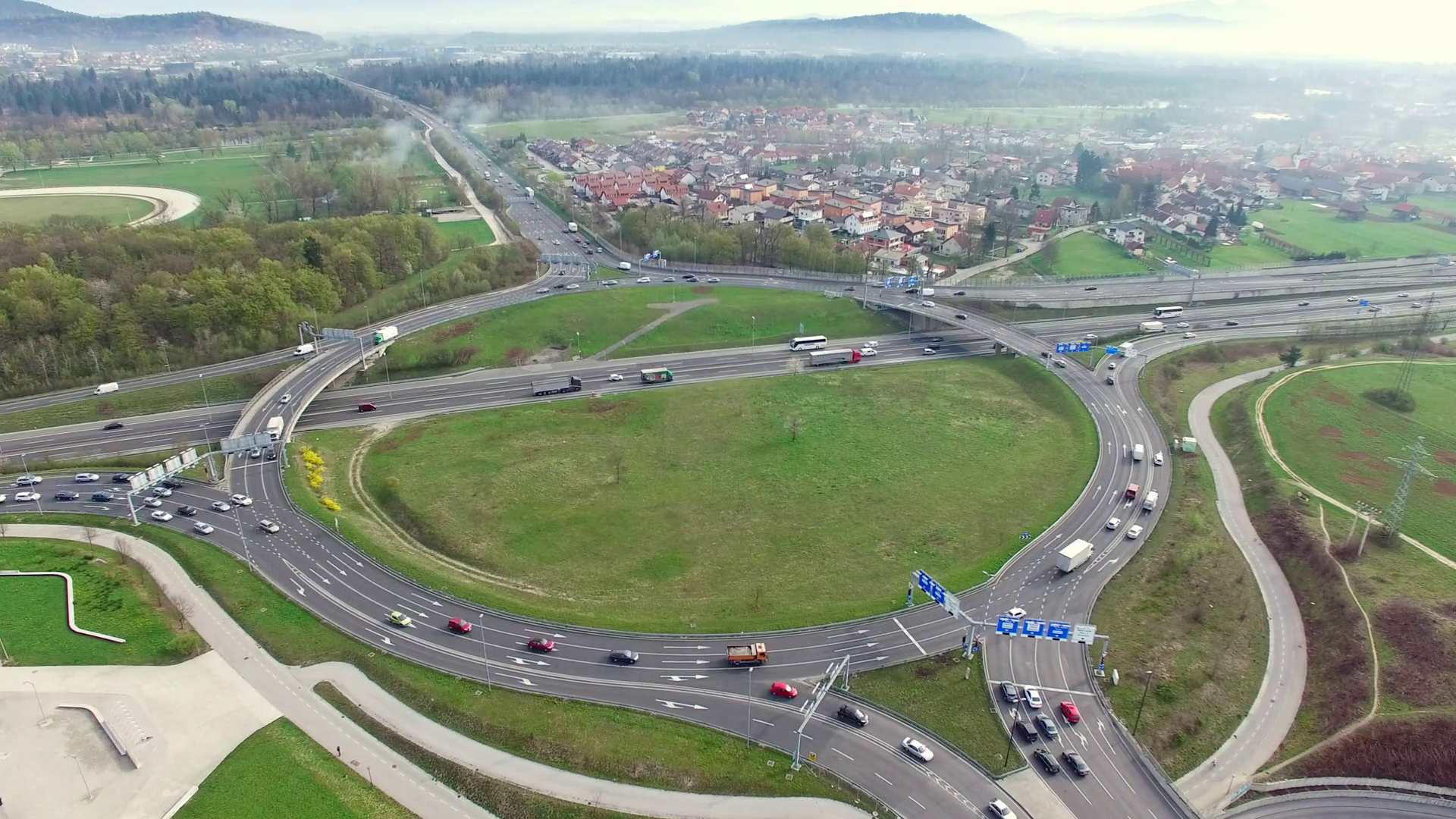 Aerial: Drone Shot Of Traffic Scene In Roundabout - Timelapse Stock ...