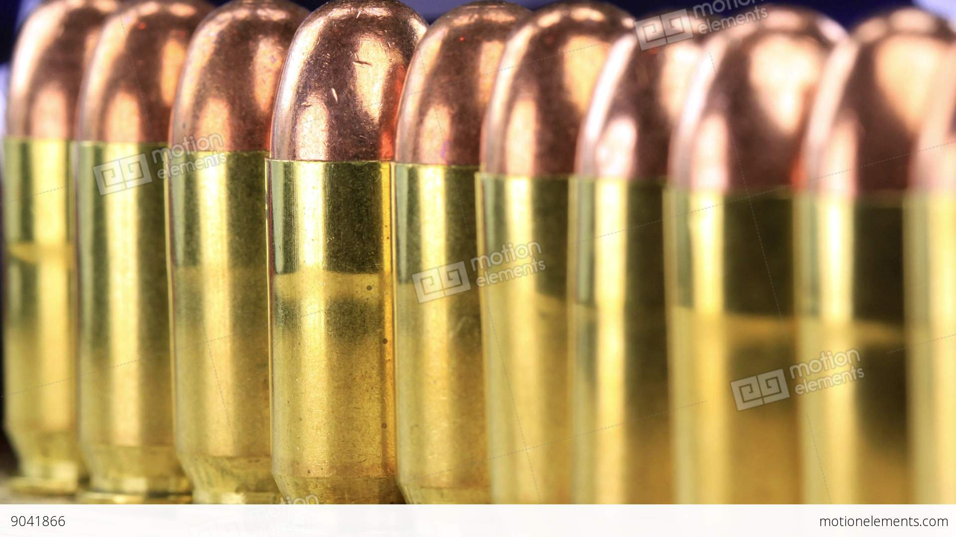 A Row Of 45 Caliber Ammunition Copper Plated Bullets With Brass ...