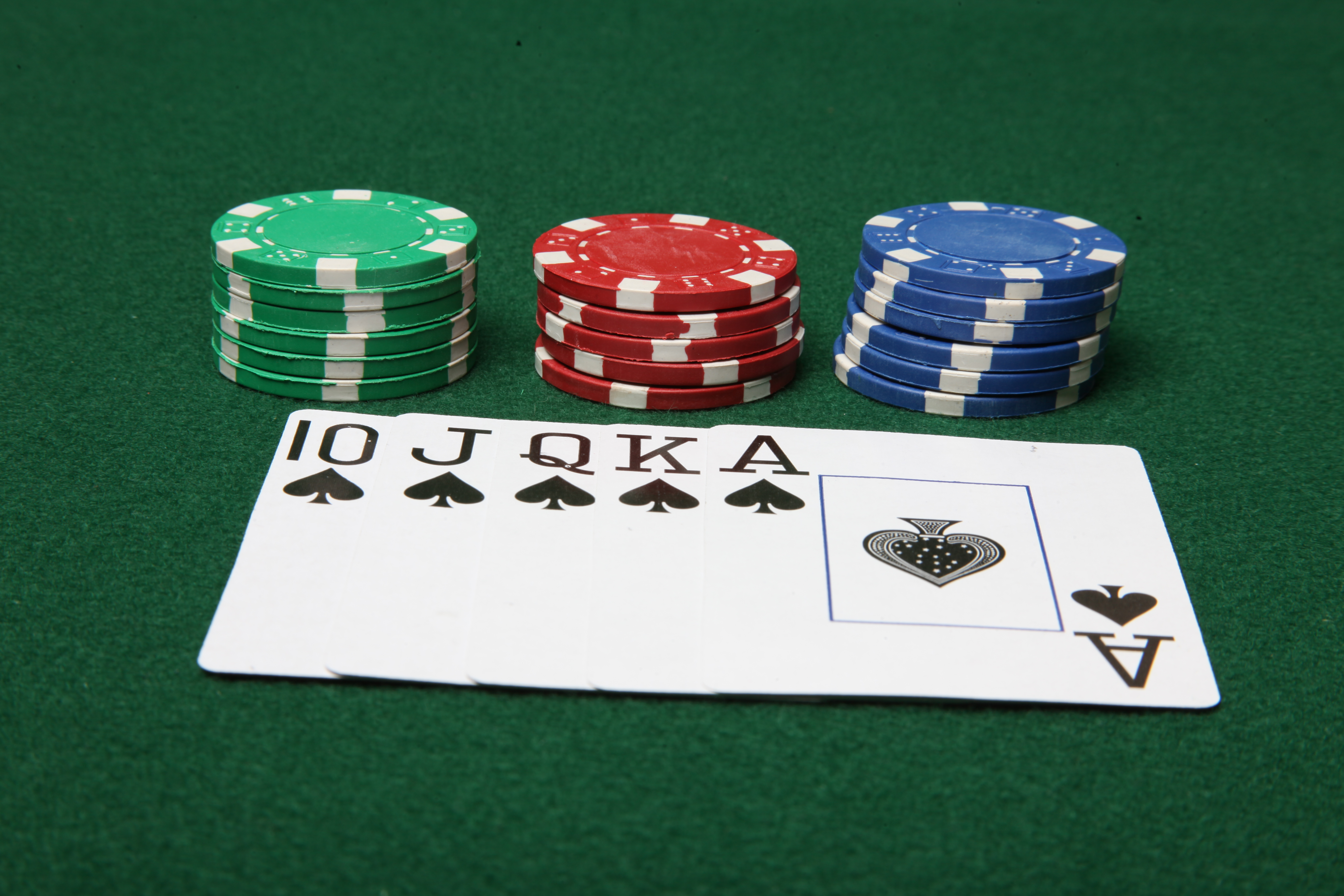 Royal flush with poker chips photo