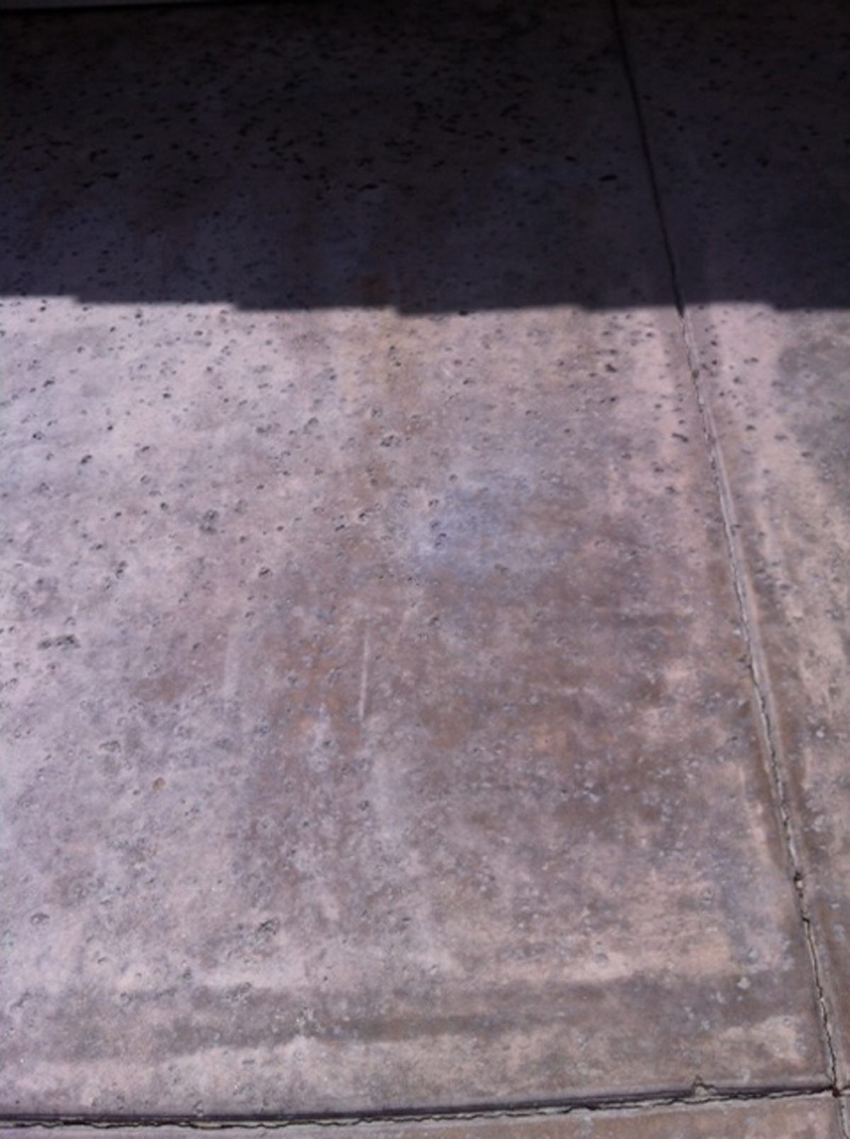 Battery Acid Stains on Colored Concrete