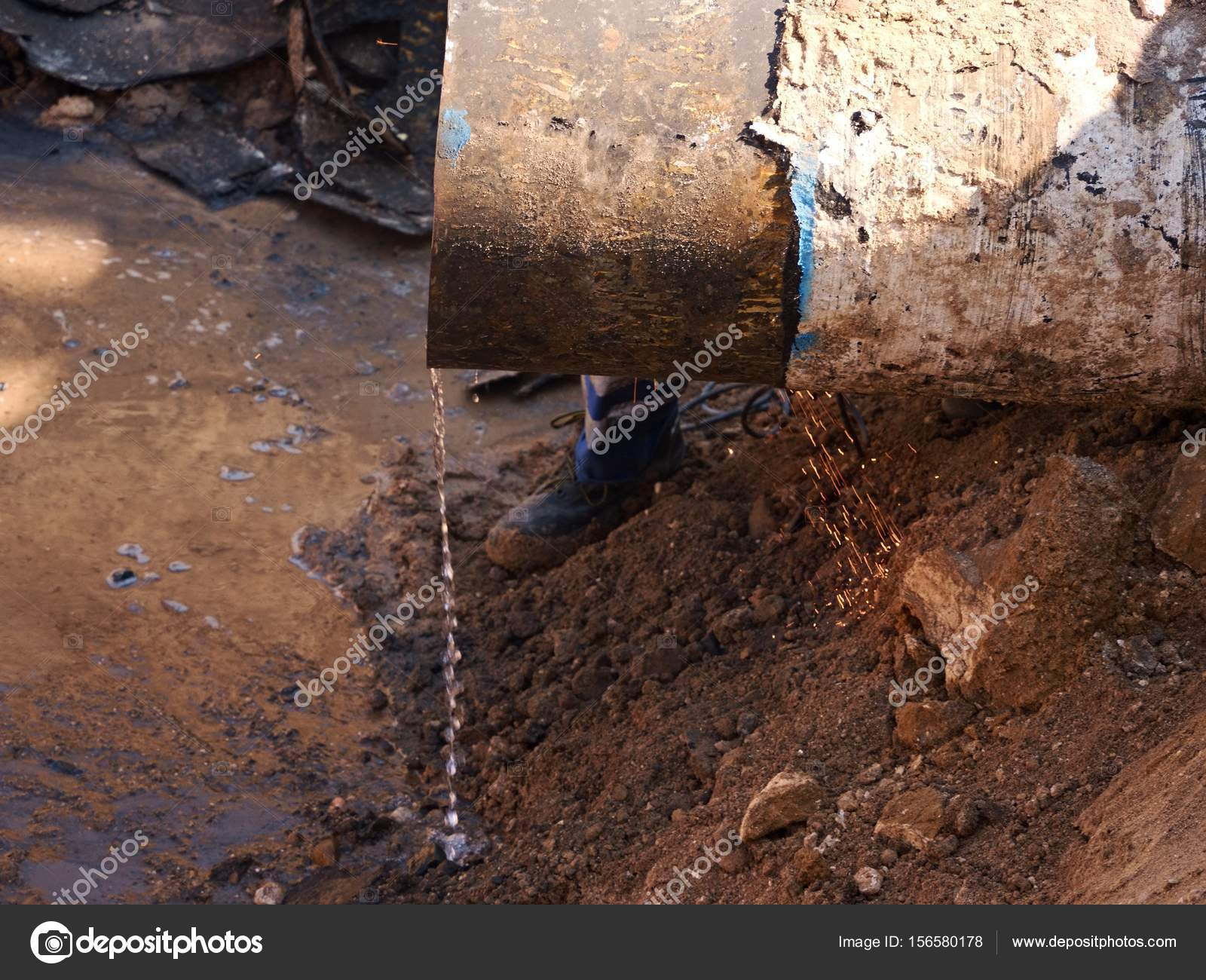 Rusty Old Iron Pipe With Clear Water Flowing From It. Waste water ...