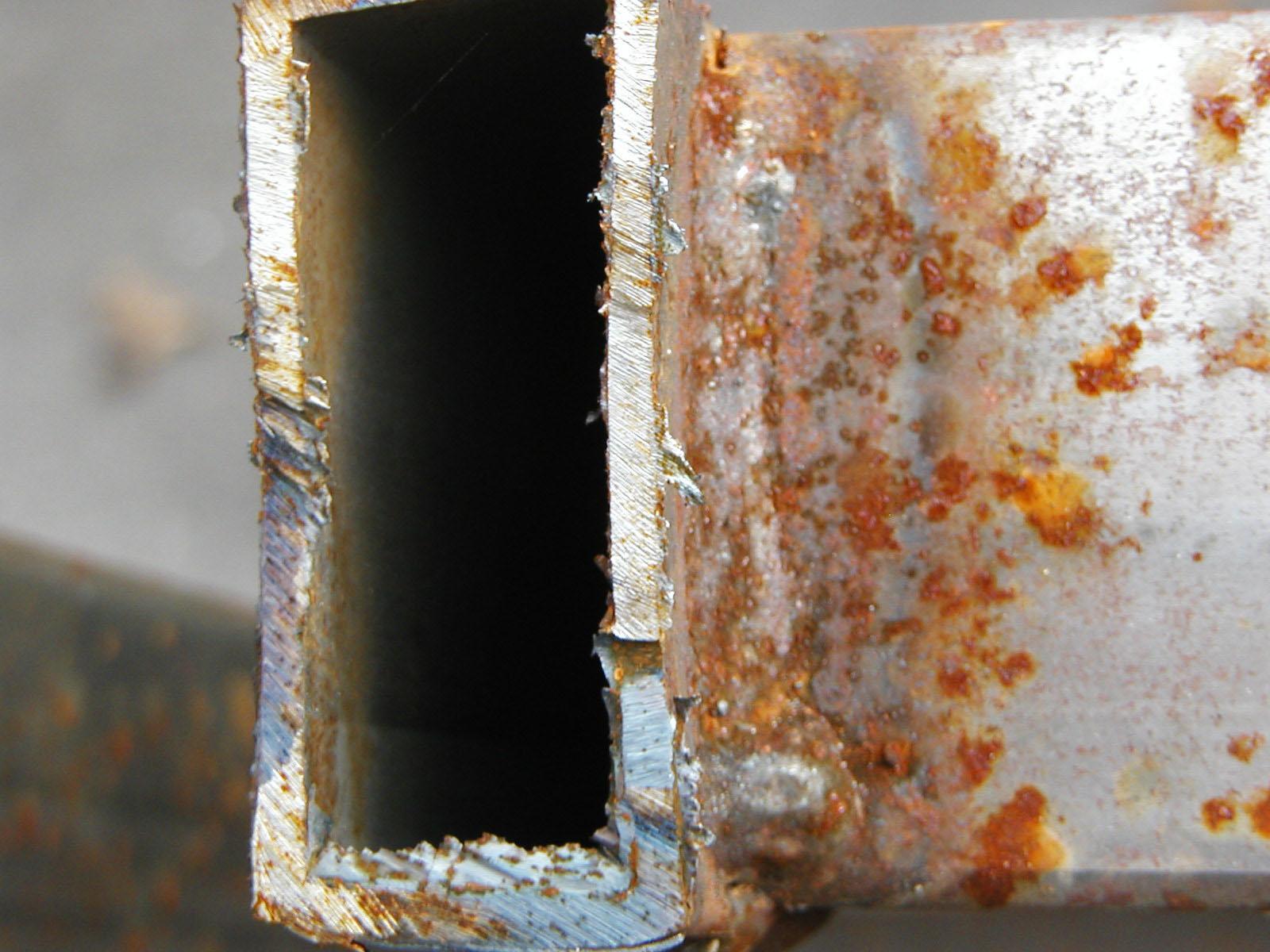 Rusted metal bar closeup photo