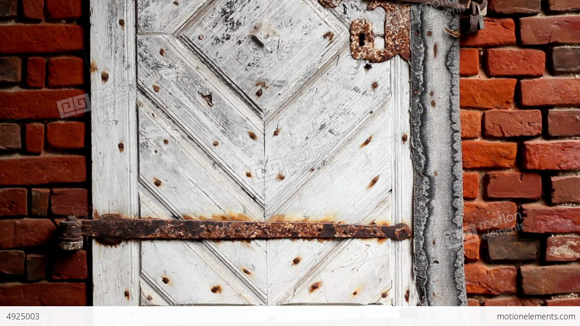 White Door Bolted With A Rusty Padlock Stock video footage   4925003