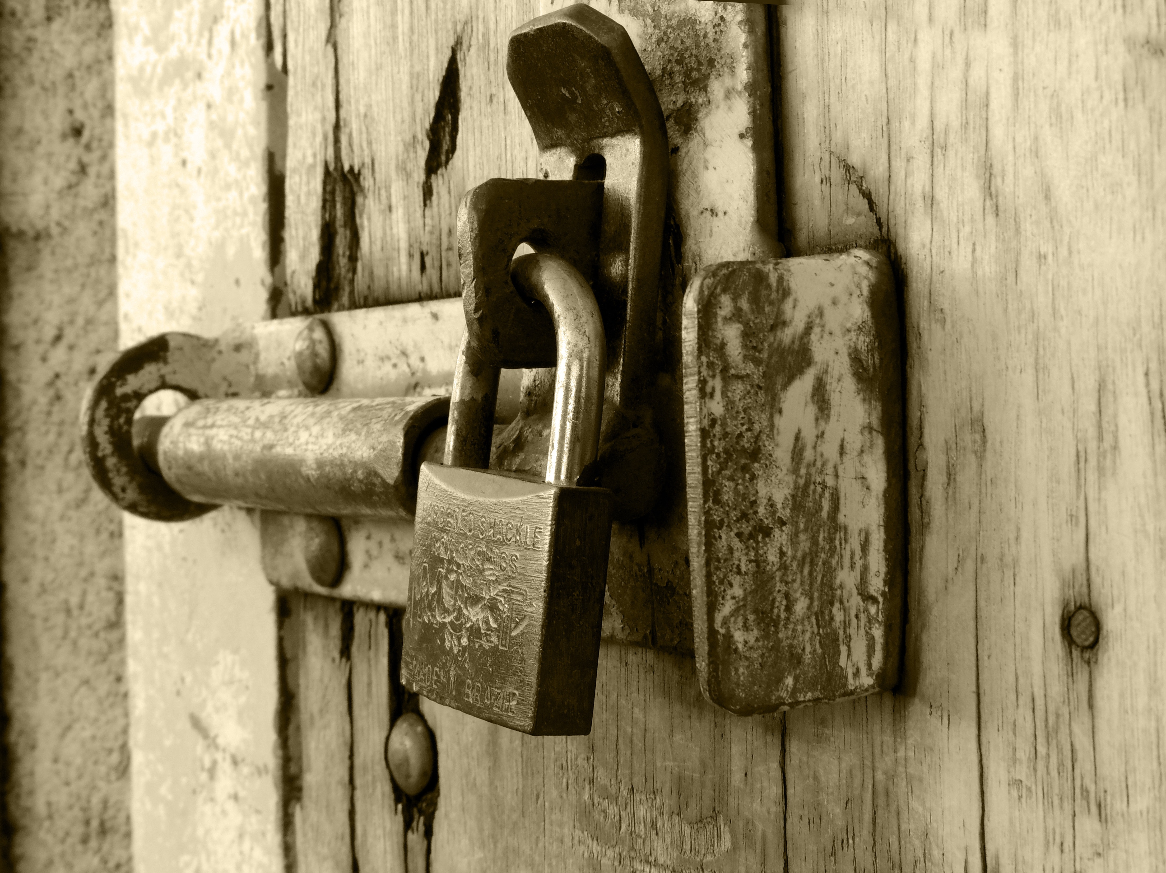 Rusted Grey Padlock in Selective-focus Photography · Free Stock Photo