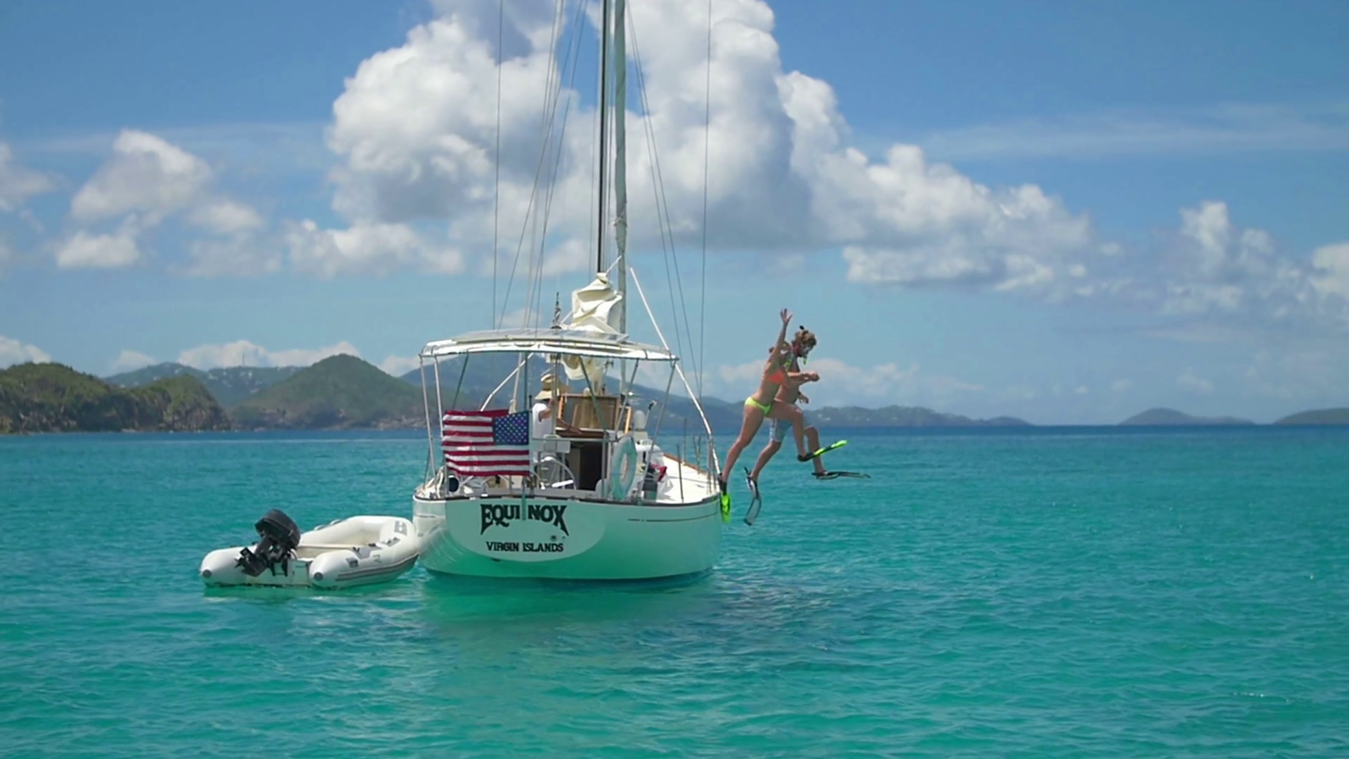 video of young couple jumping off sailboat in Caribbean Stock Video ...