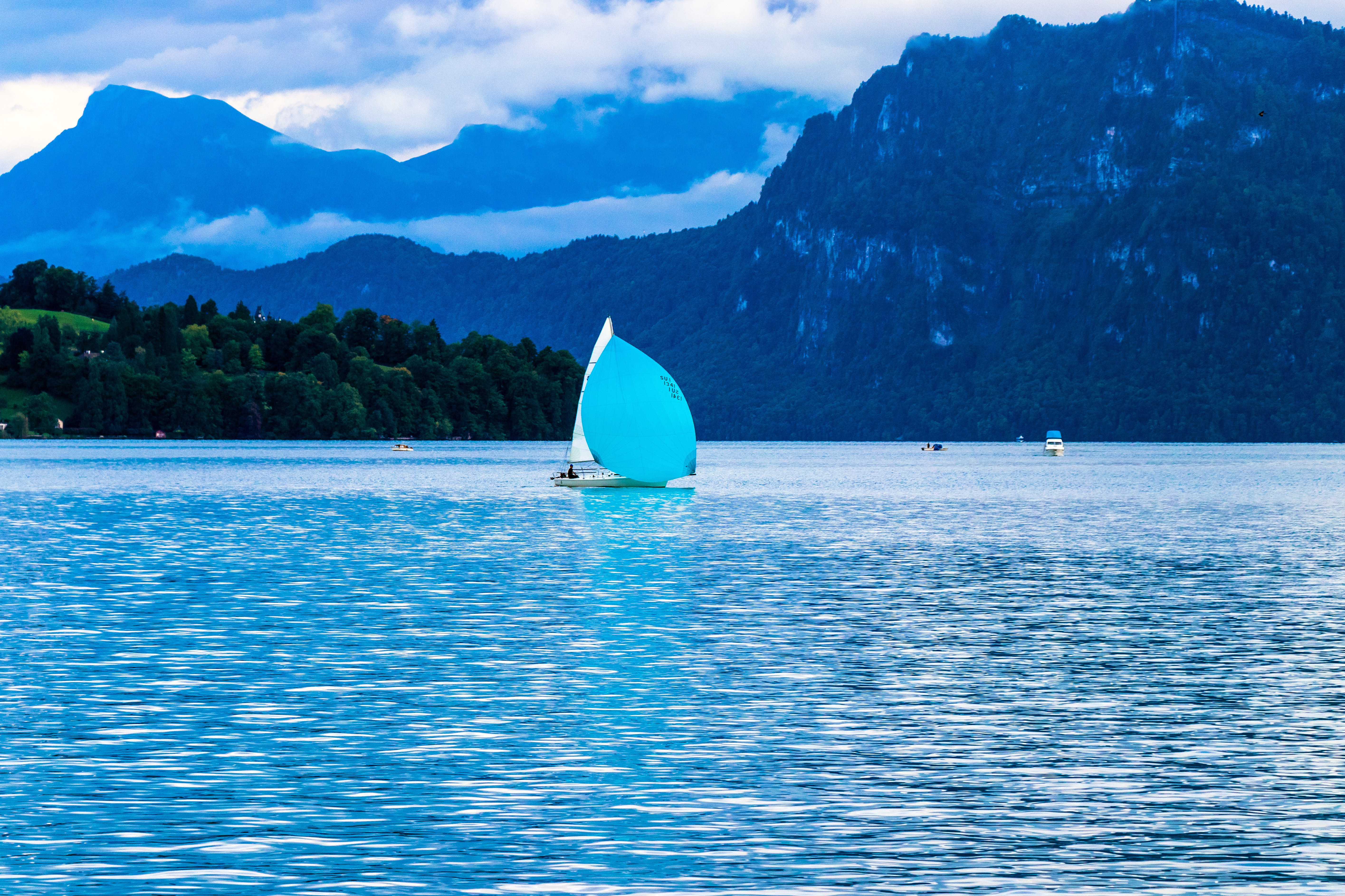 Sailing boat on body of water photo