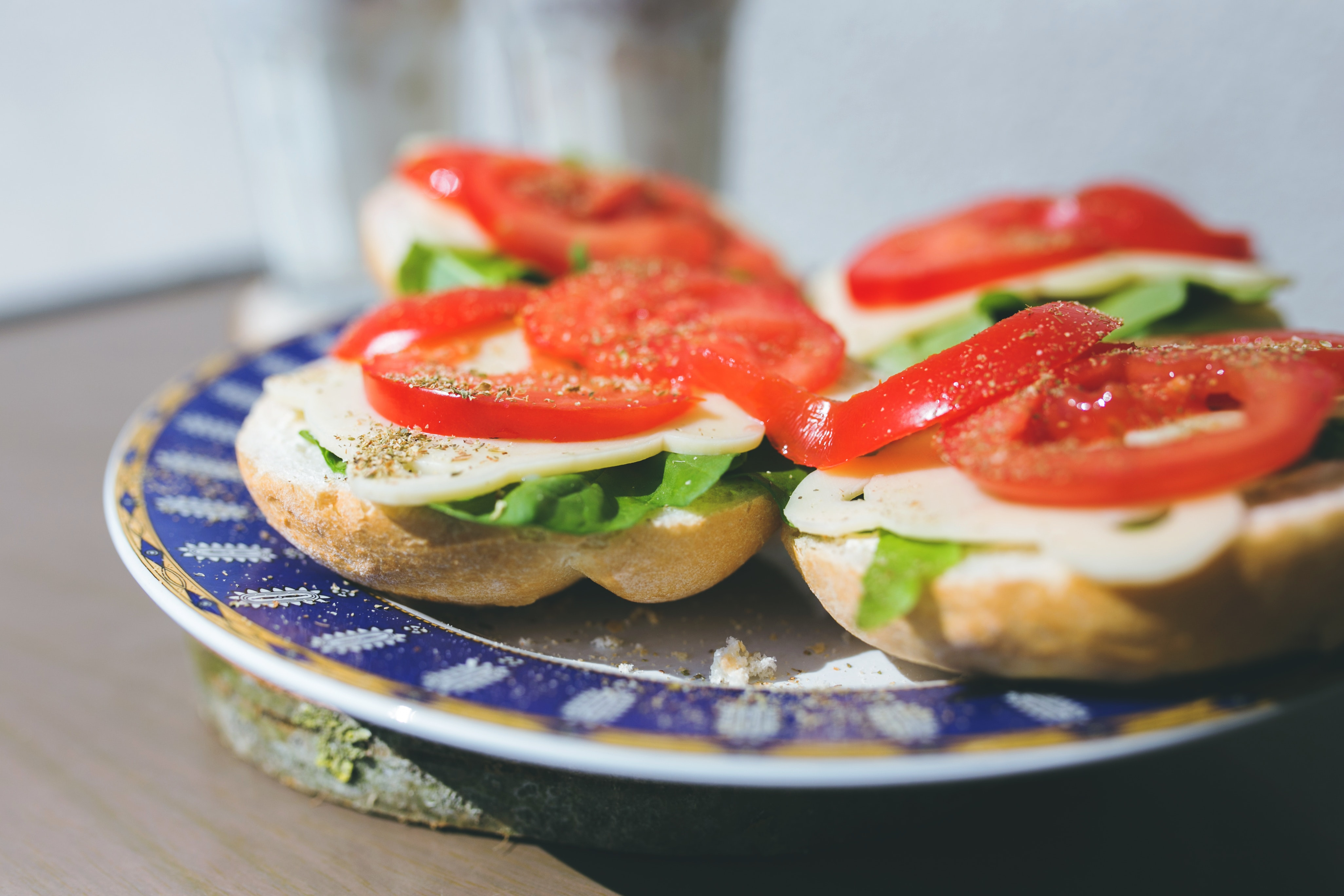 Sandwiches with cheese, lettuce and tomato on a plate photo