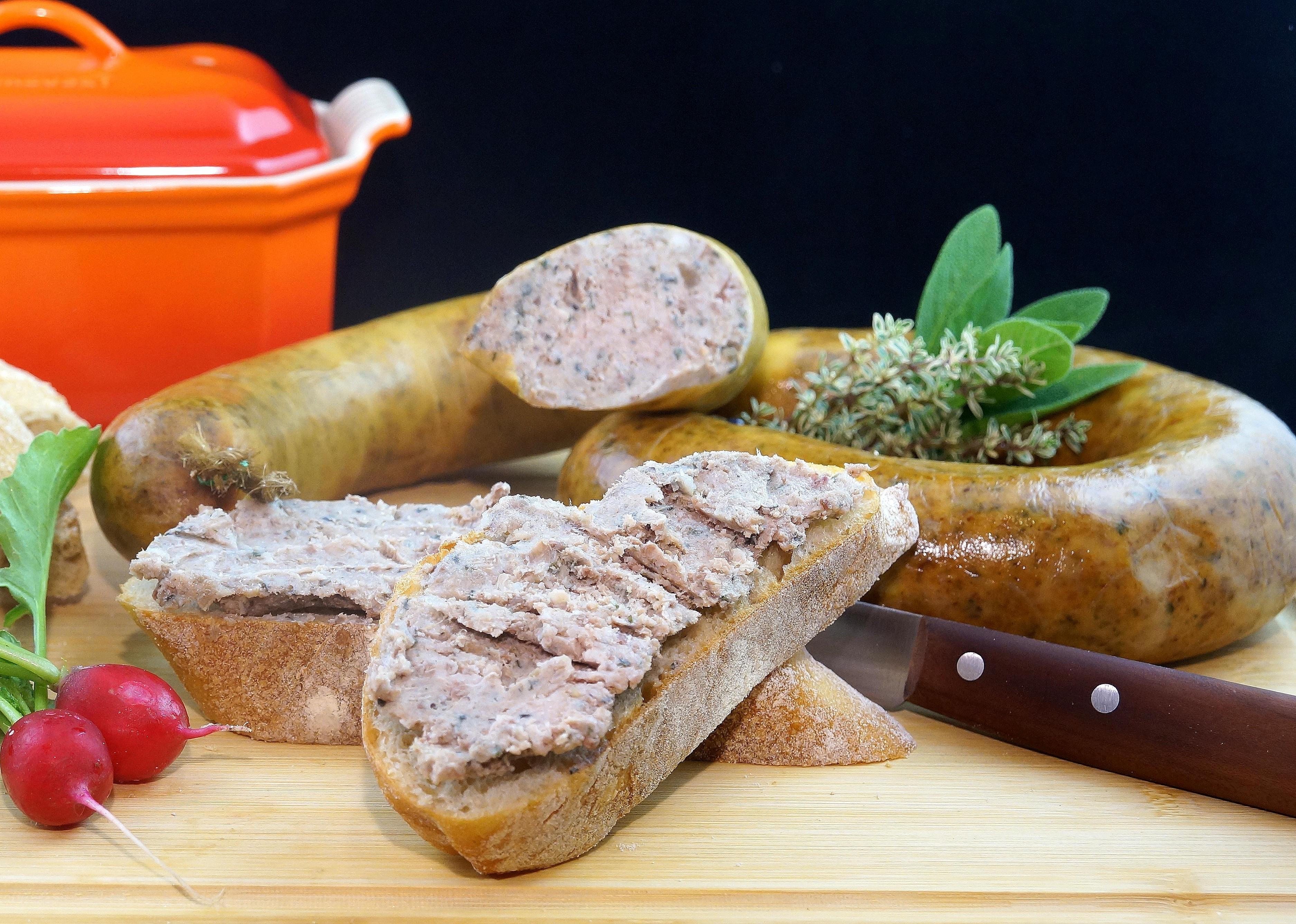 Sausage near kitchen knife photo