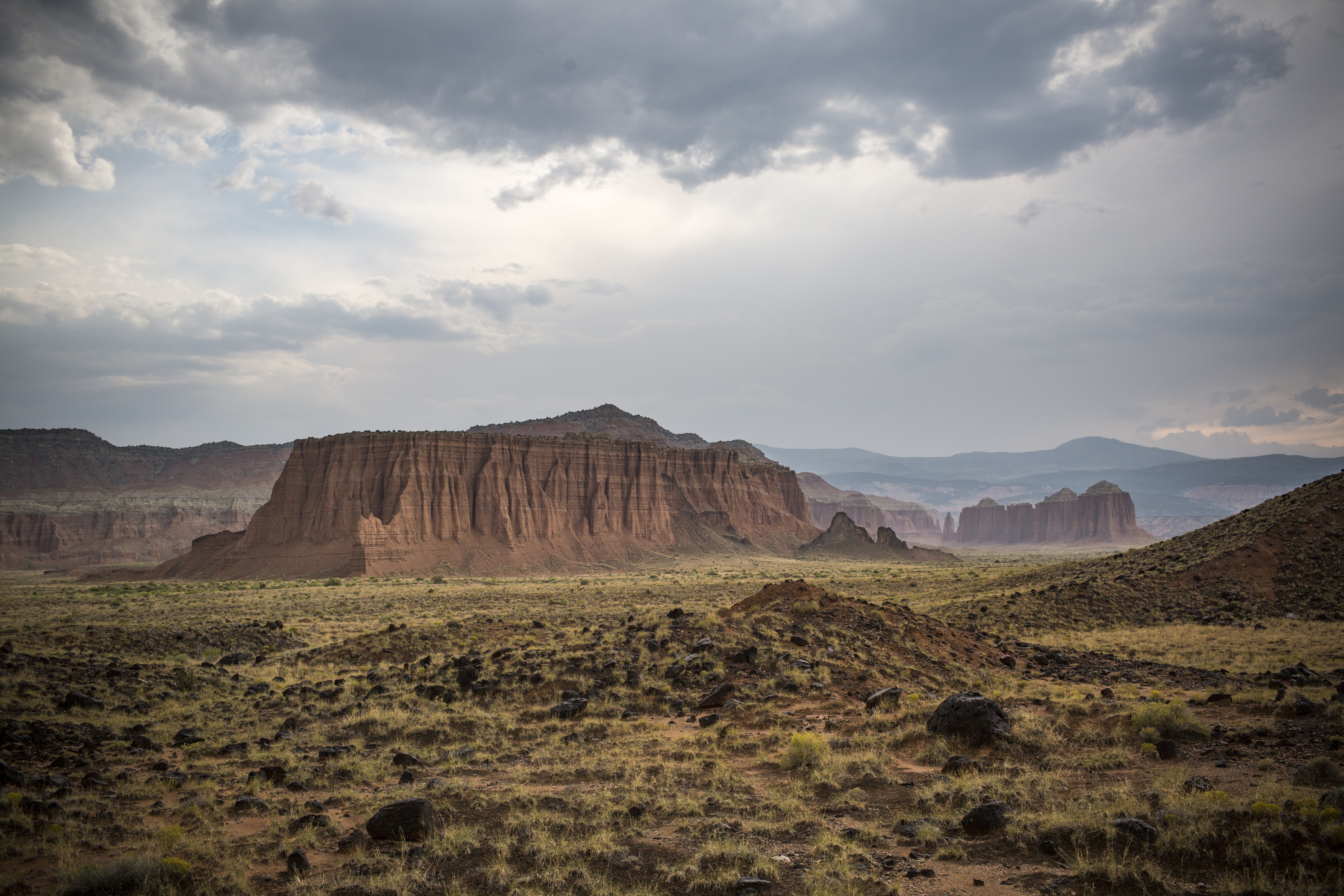 Scenic view of desert landscape against dramatic sky photo