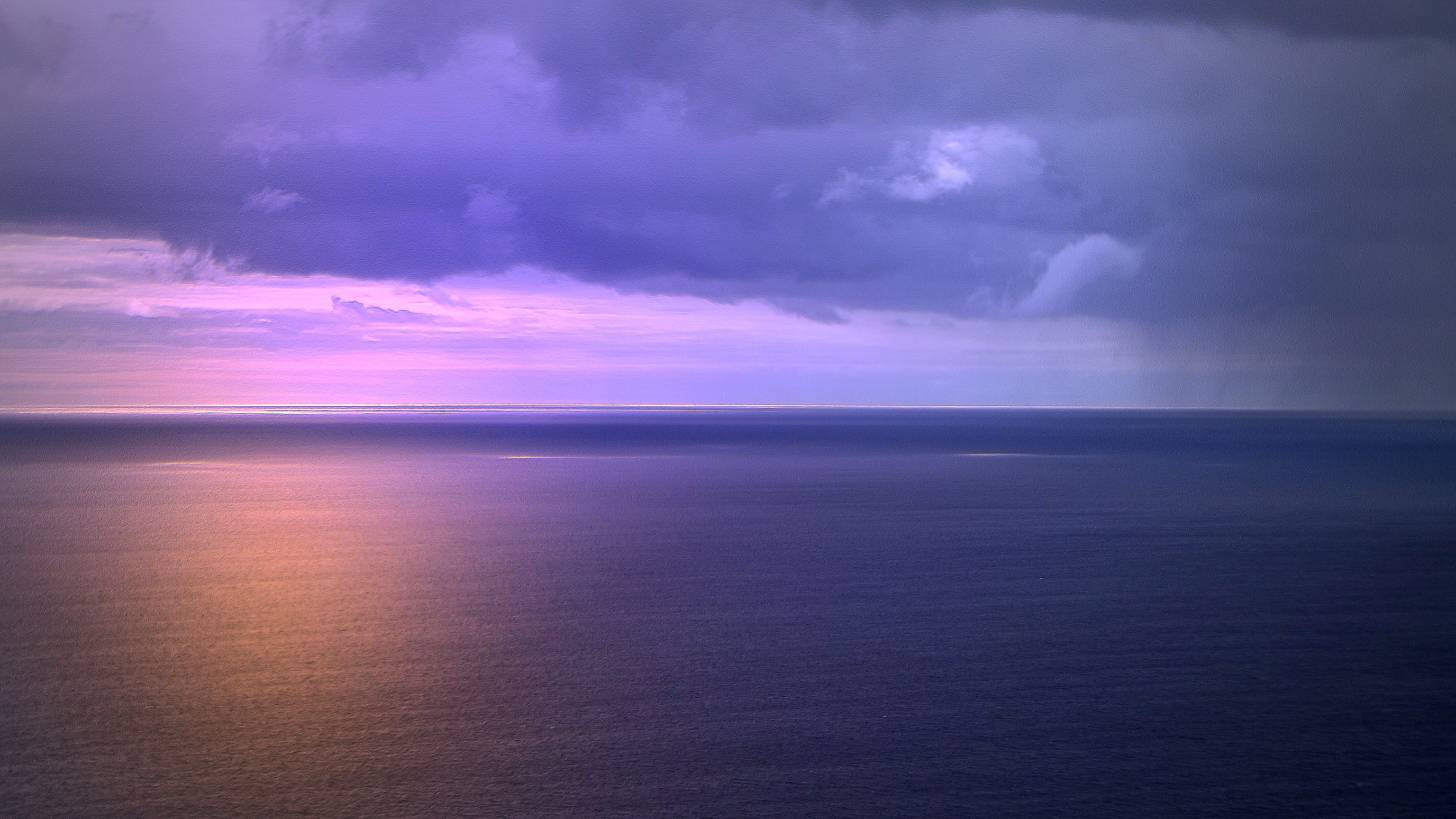 Scenic view of dramatic sky over sea photo