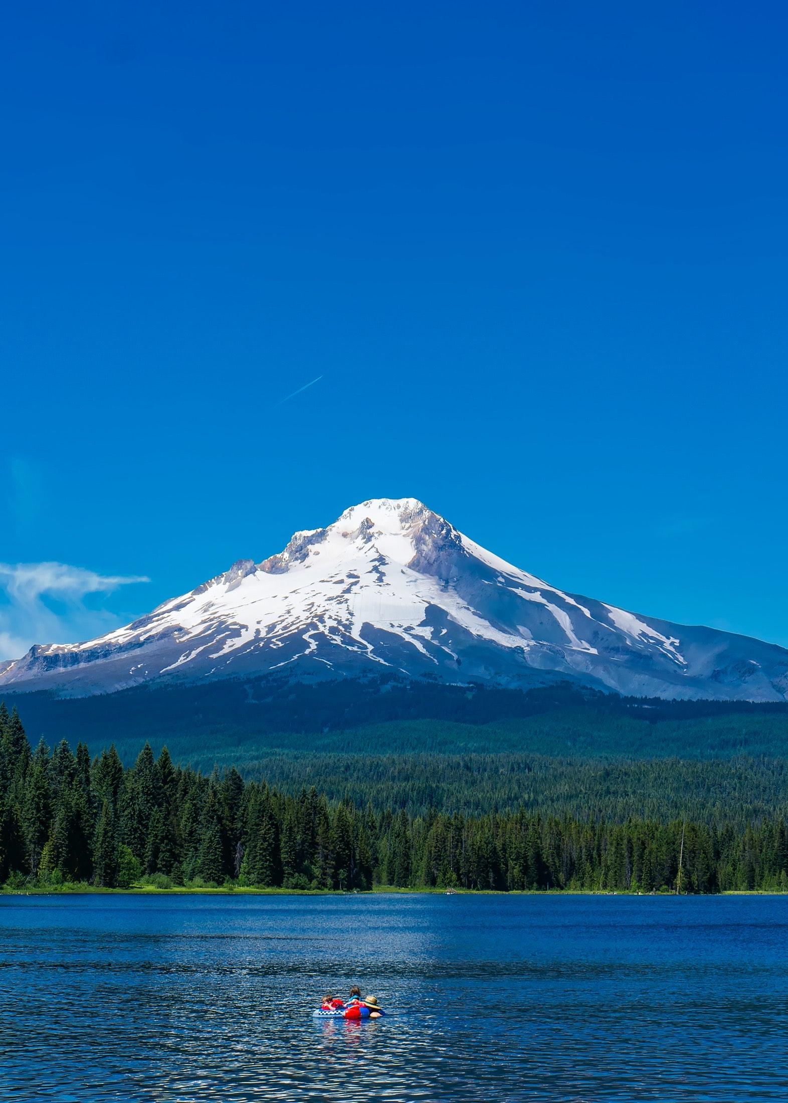 Scenic view of lake against mountain range photo