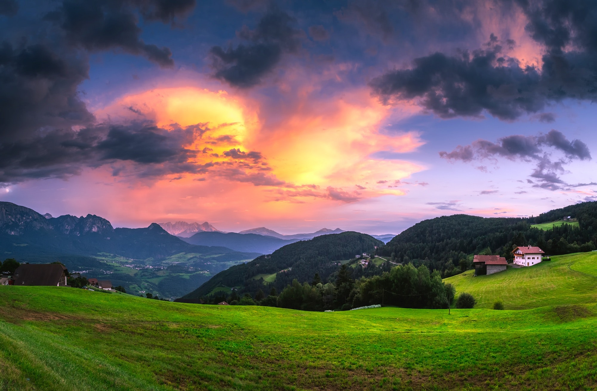 Scenic view of landscape against cloudy sky photo
