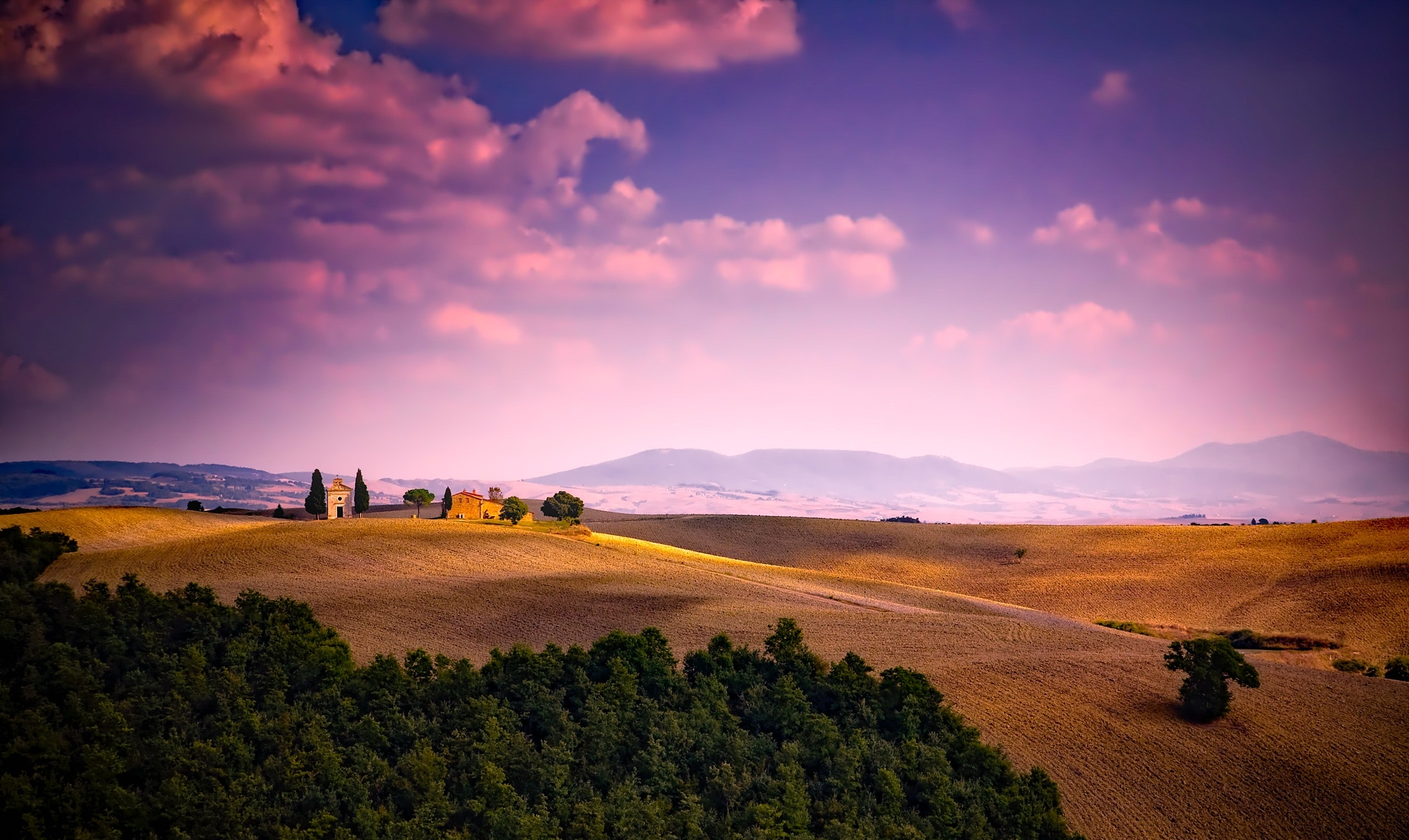 Scenic view of landscape against dramatic sky photo