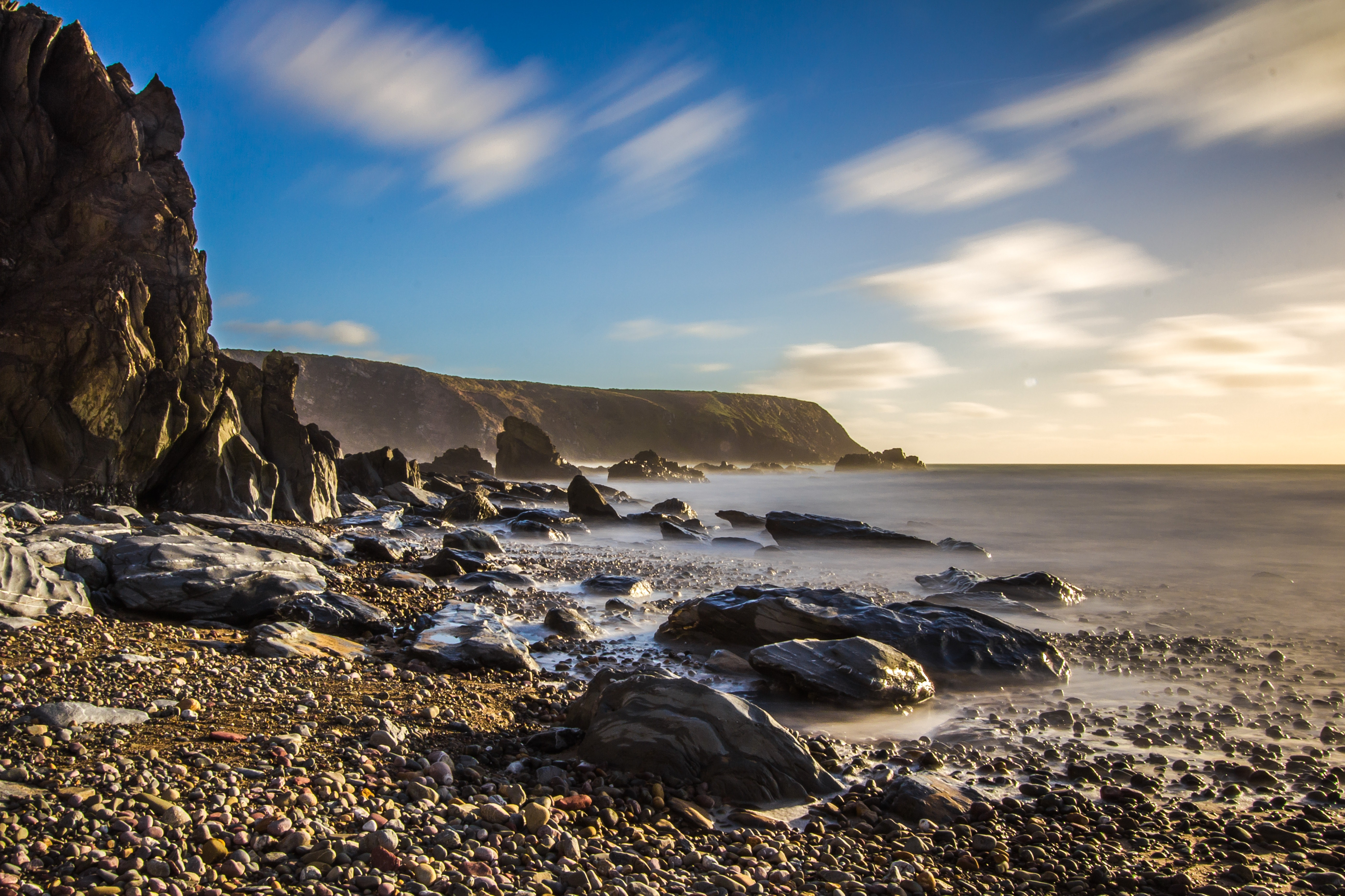 Scenic view of sea against dramatic sky photo