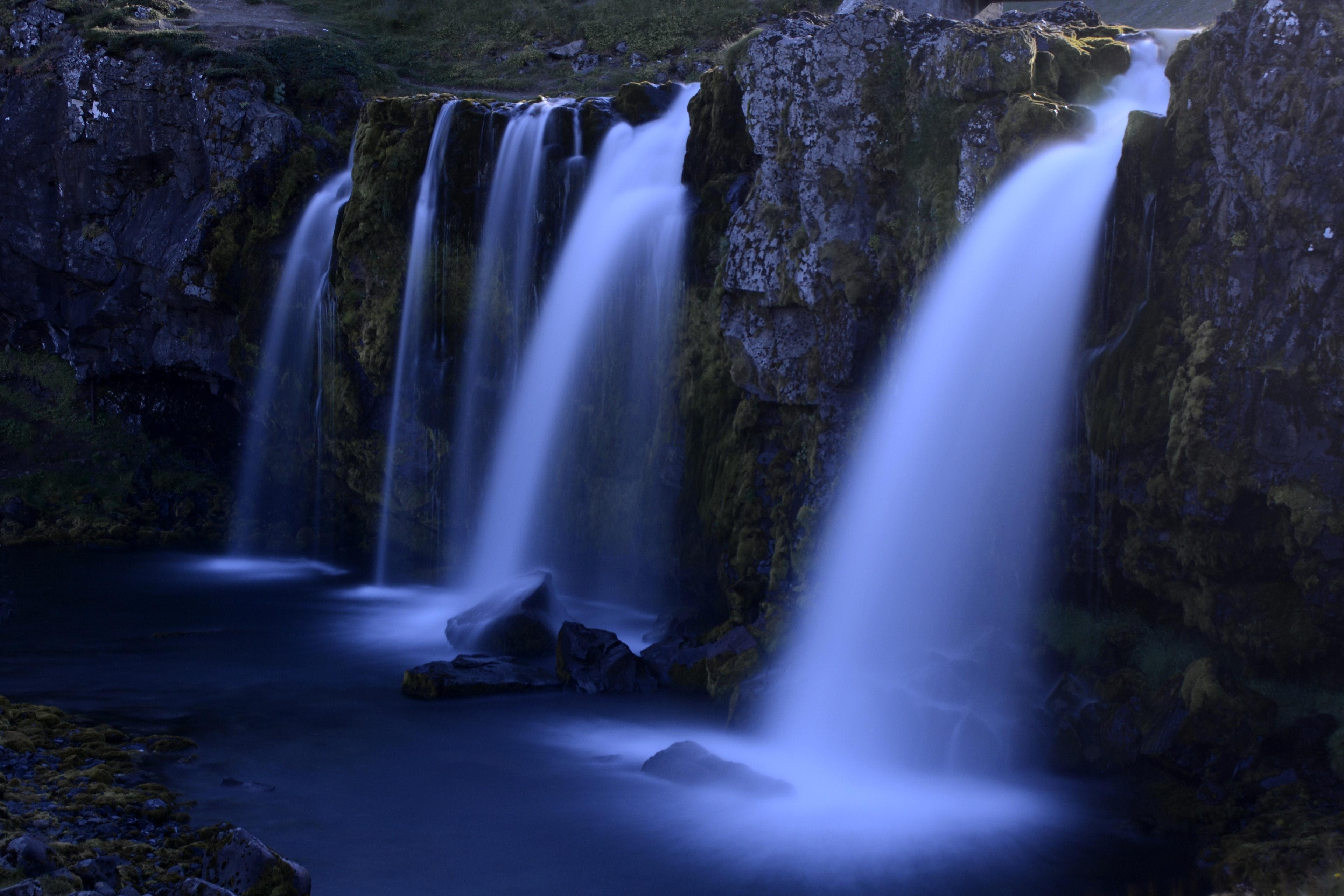 Scenic view of waterfall photo