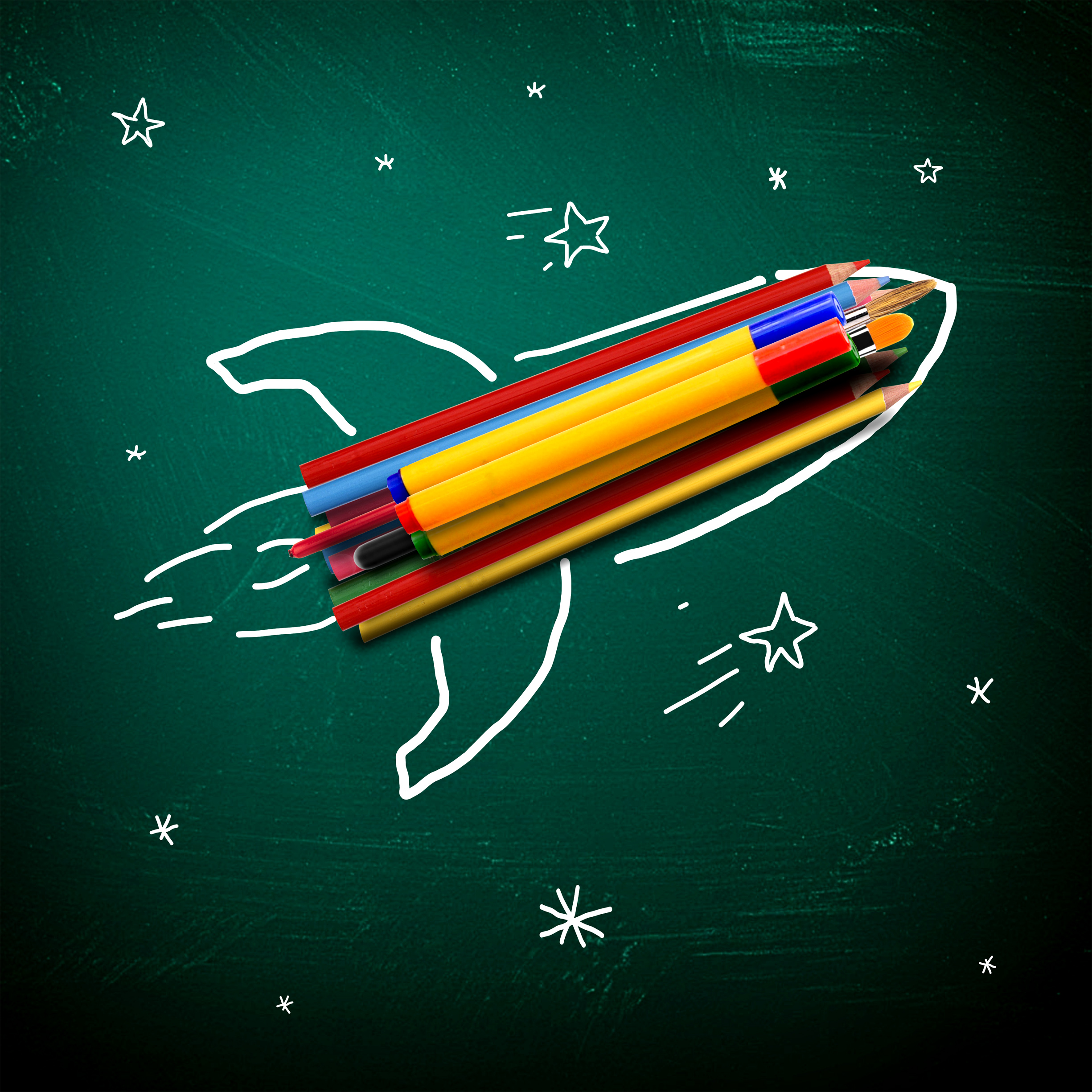 School stationery on a rocket - school and learning concept photo