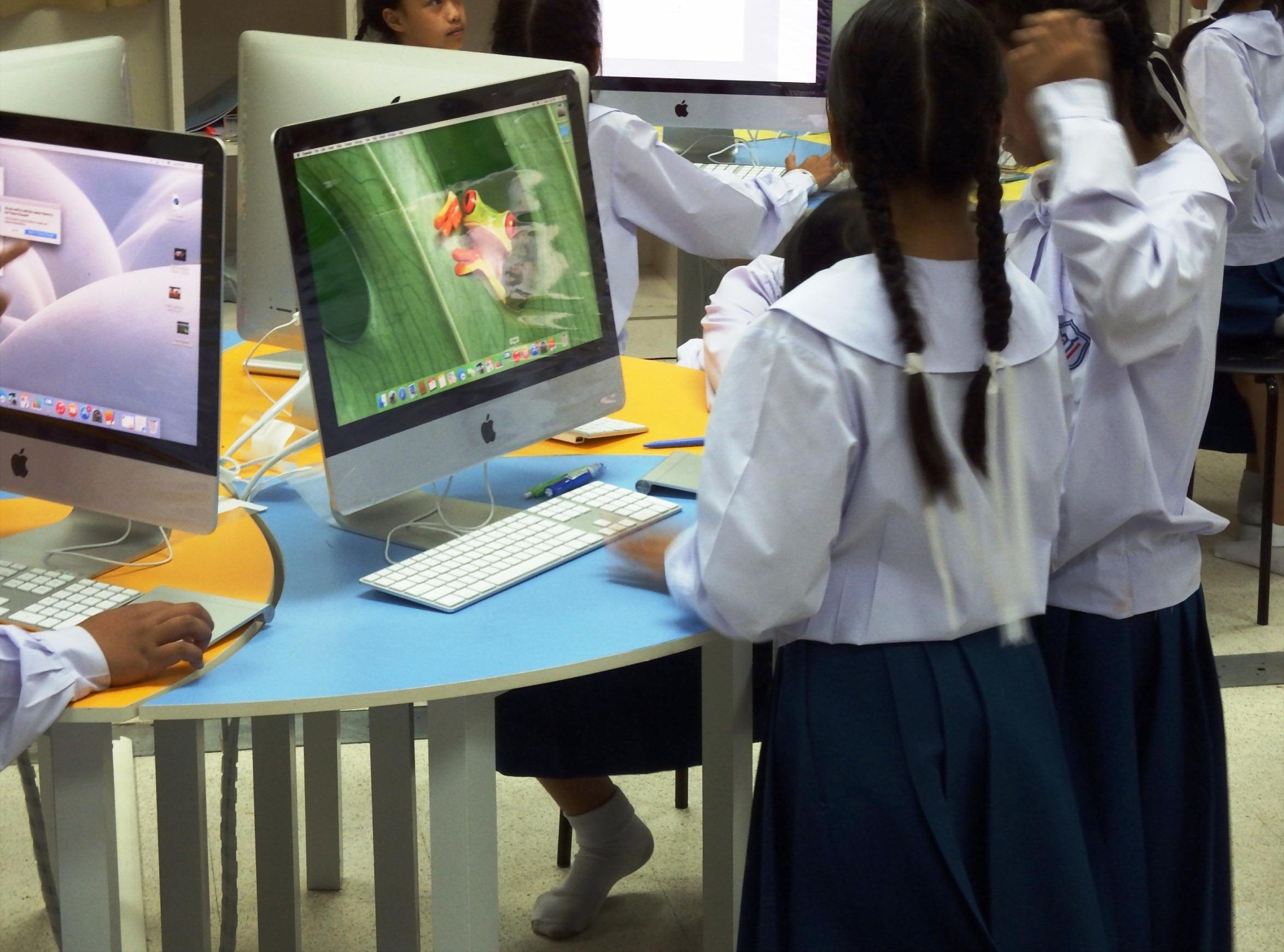 School students using apple macs photo