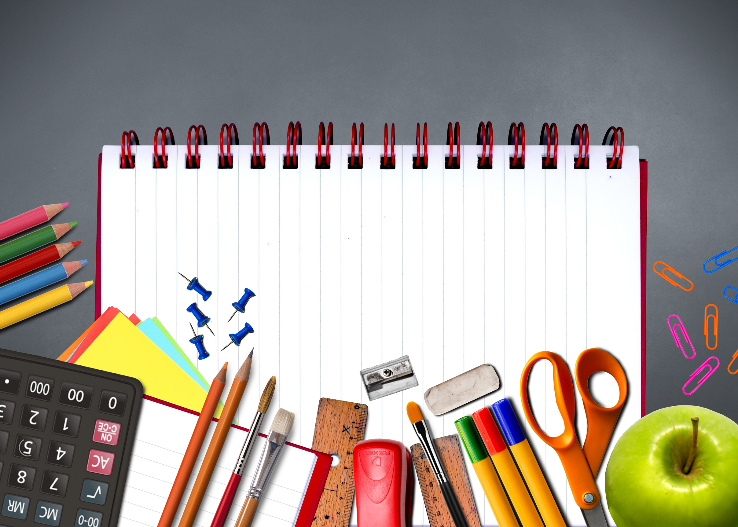 School supplies on notebook - study and learning concept photo
