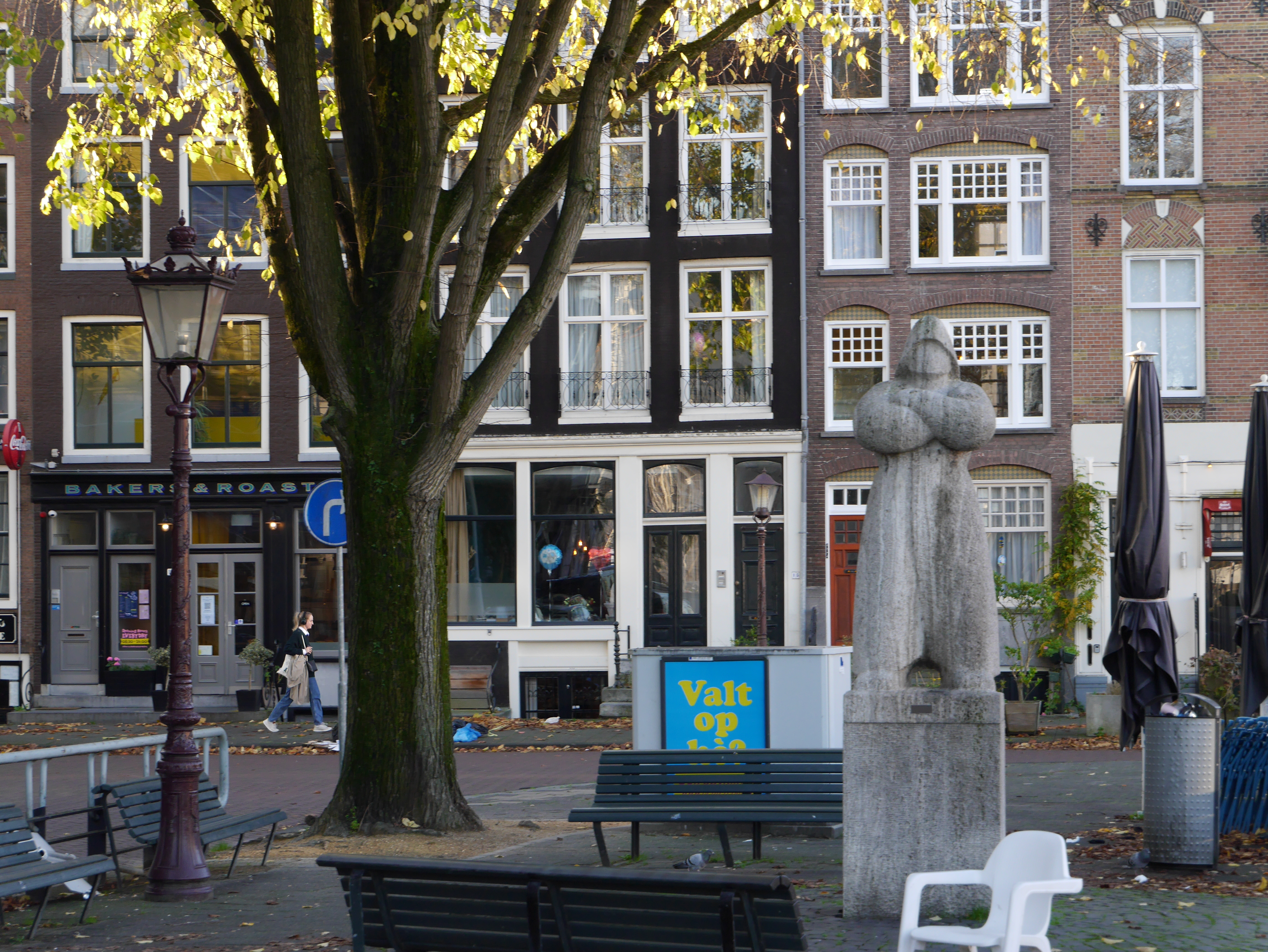 sculpture in the street with a autumn tree, in the city Amsterdam, Netherlands., sculpture in the street with a autumn tree, in the city Amsterdam, Netherlands.