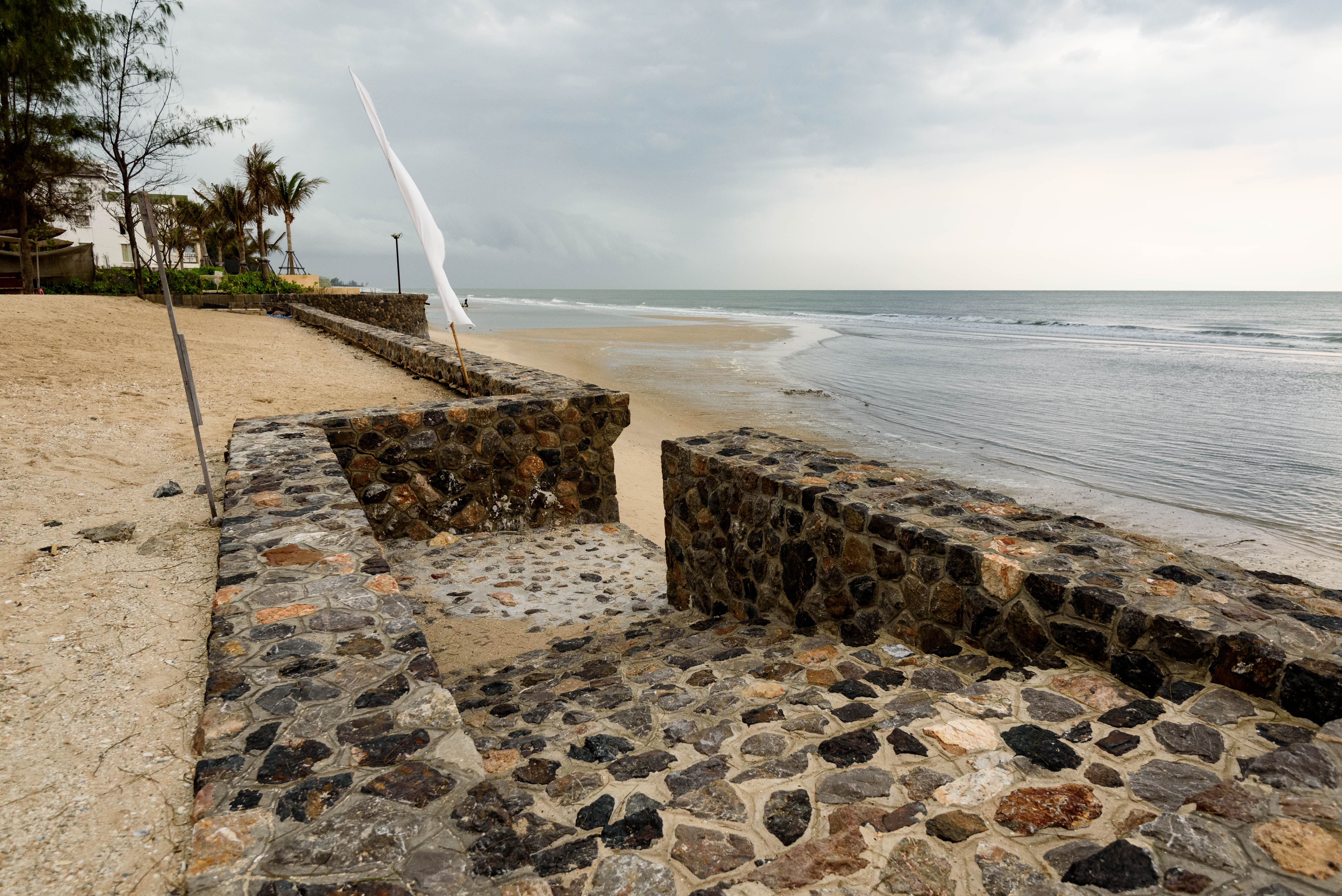 Sea wall at the so sofitel hua hin resort on cha-am beach, thailand. photo