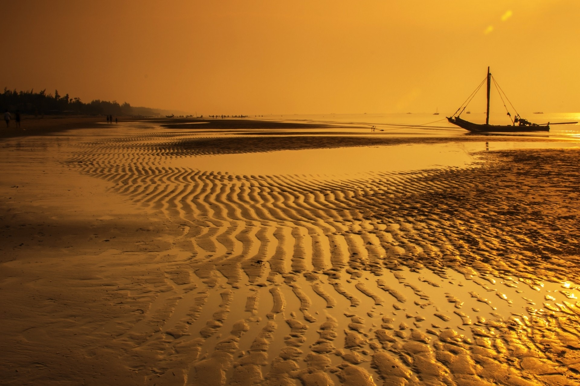 Sea water with boat during sunset photo