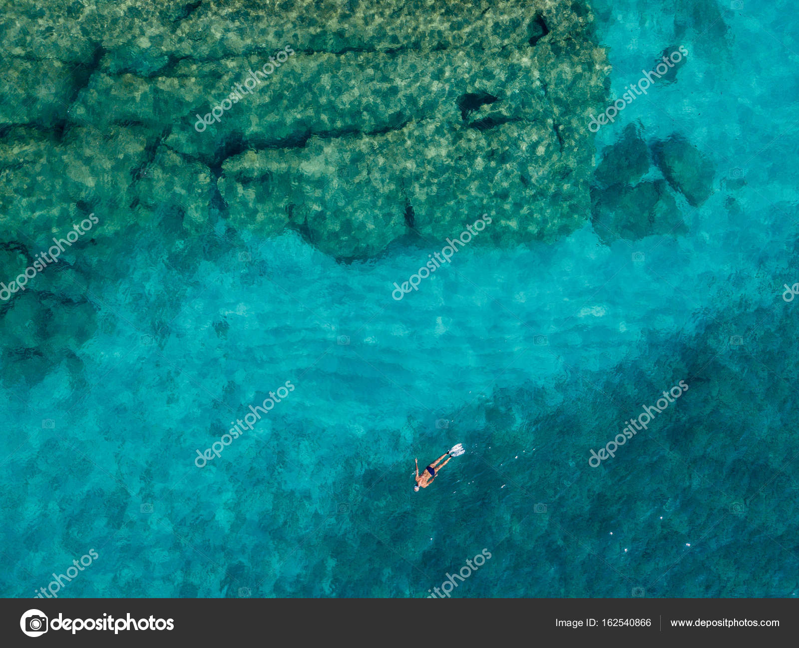 Aerial view of rocks on the sea. Overview of seabed seen from above ...