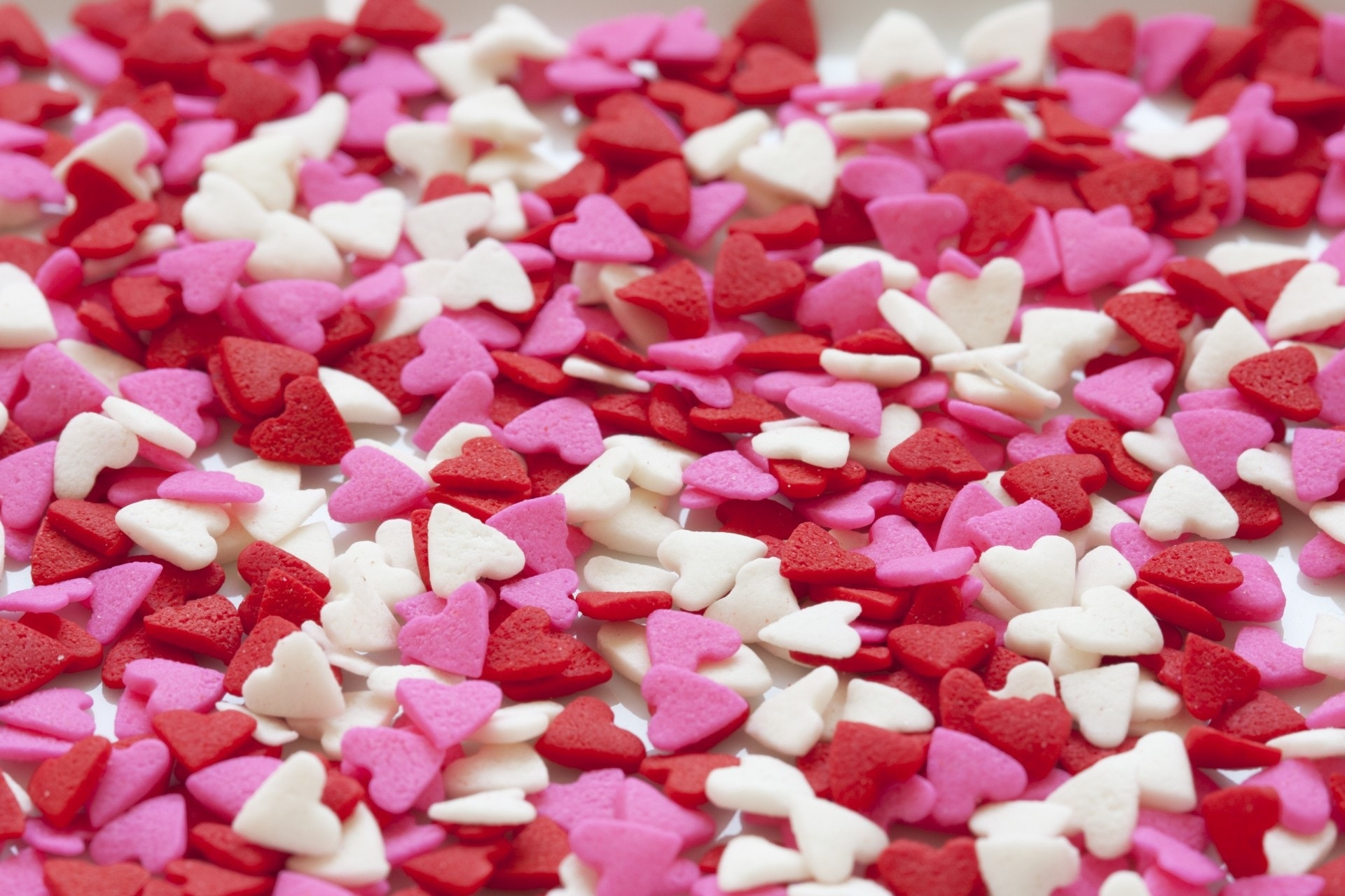 Selective focus of white red and pink hearts sprinkles photo